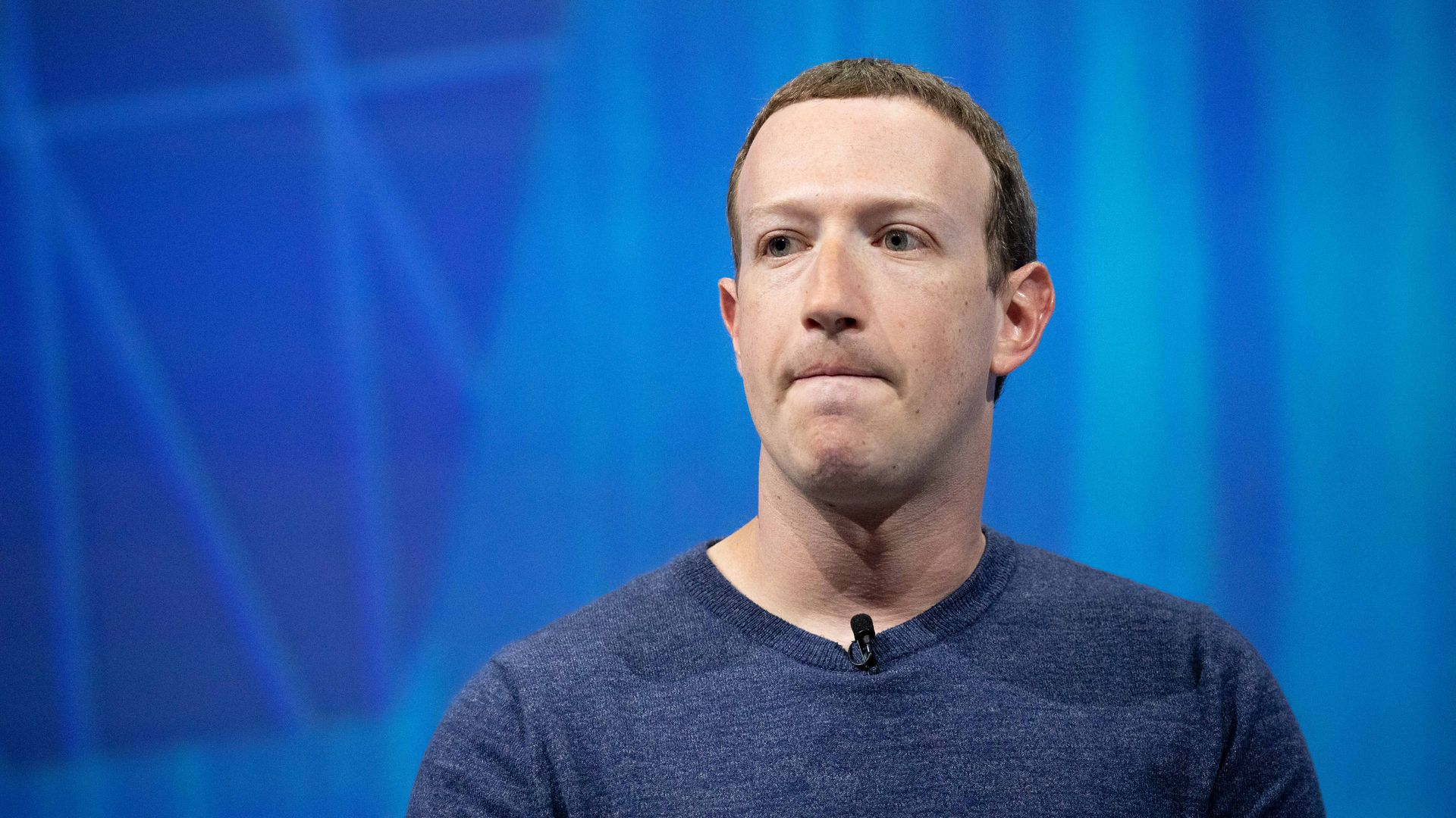 Mark Zuckerberg bites his lip.