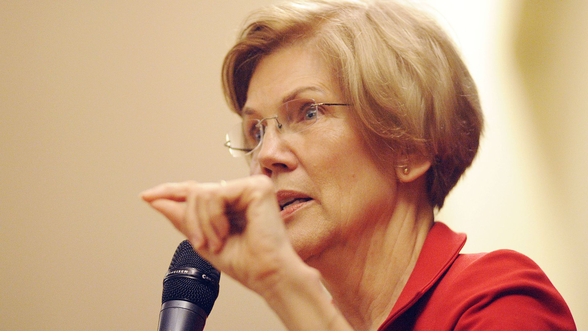 Wlizabeth Warren close up with a microphone.