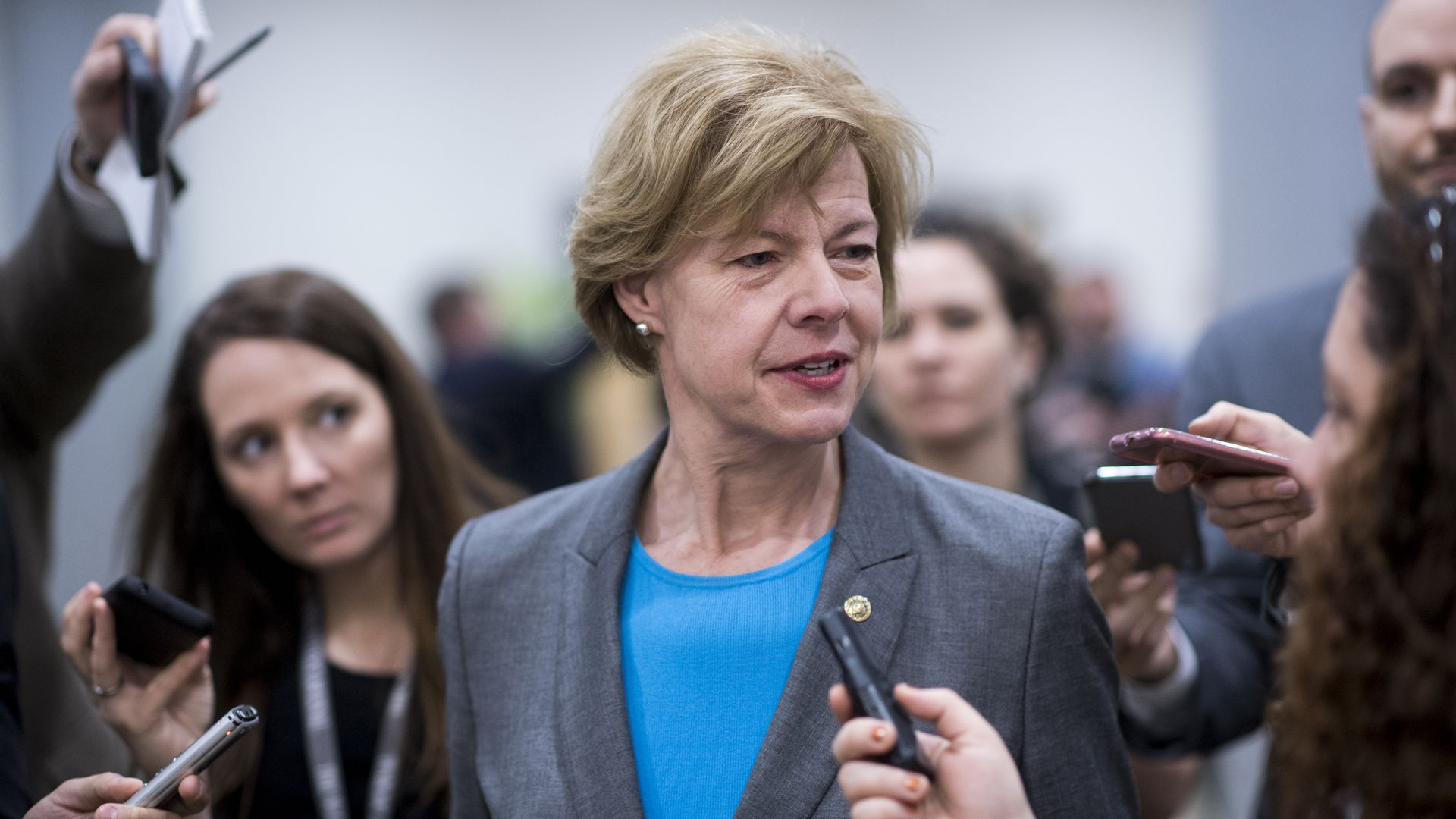 Senator Tammy Baldwin speaks to a group of reporters
