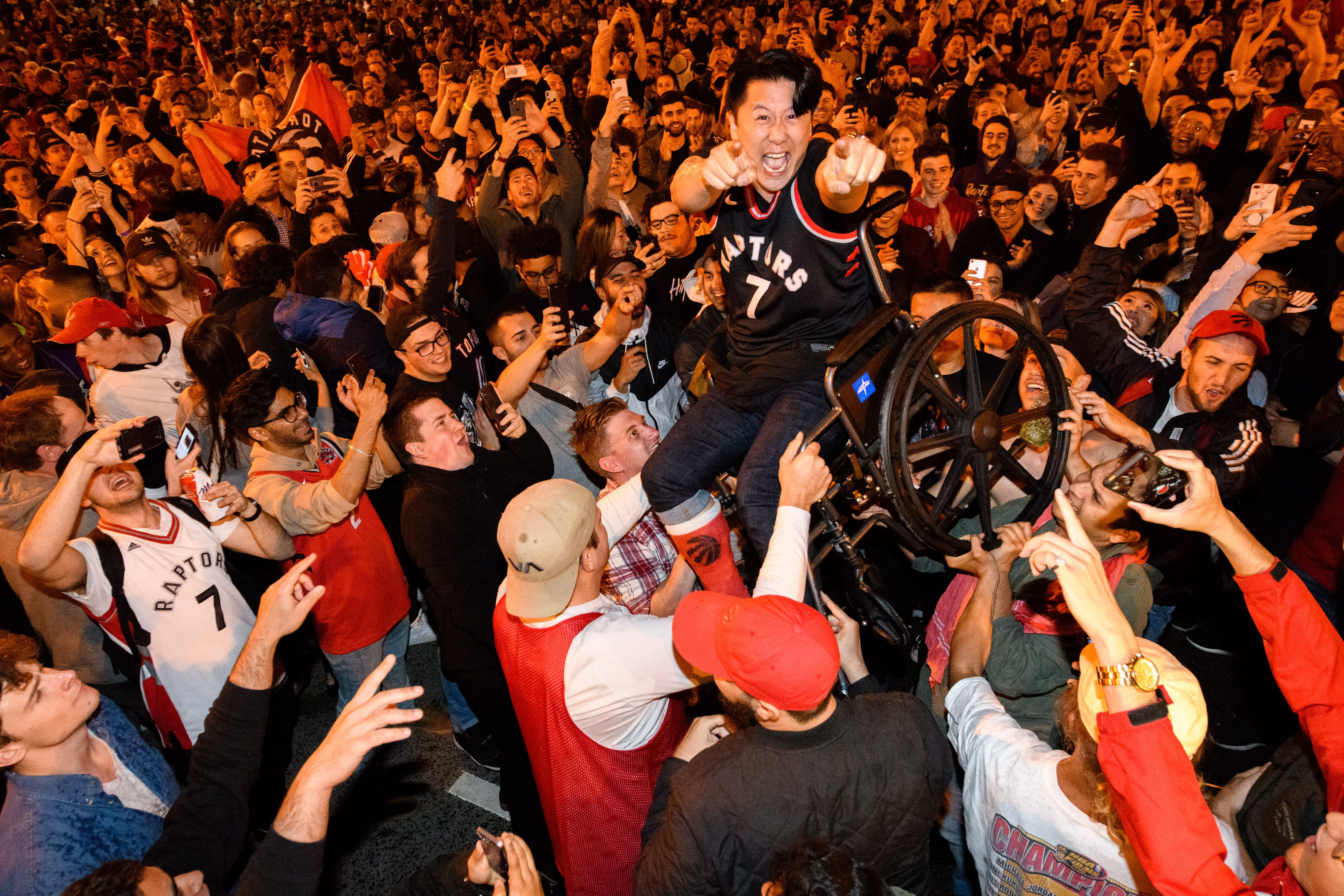 Raptors fans celebrating in Toronto