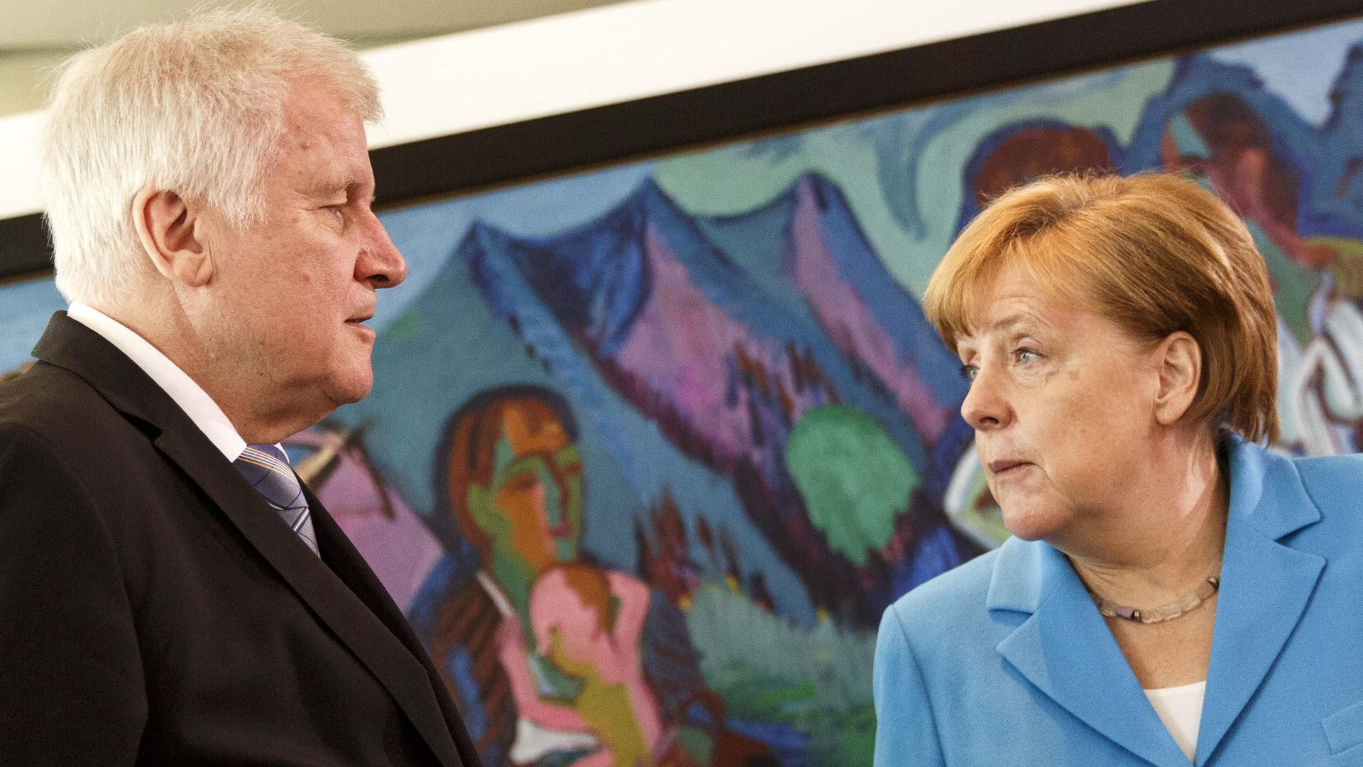 German Chancellor Angela Merkel speaks to German Interior Minister Horst Seehofer after the arrival for the weekly government cabinet meeting on June 13, 2018 in Berlin, Germany.
