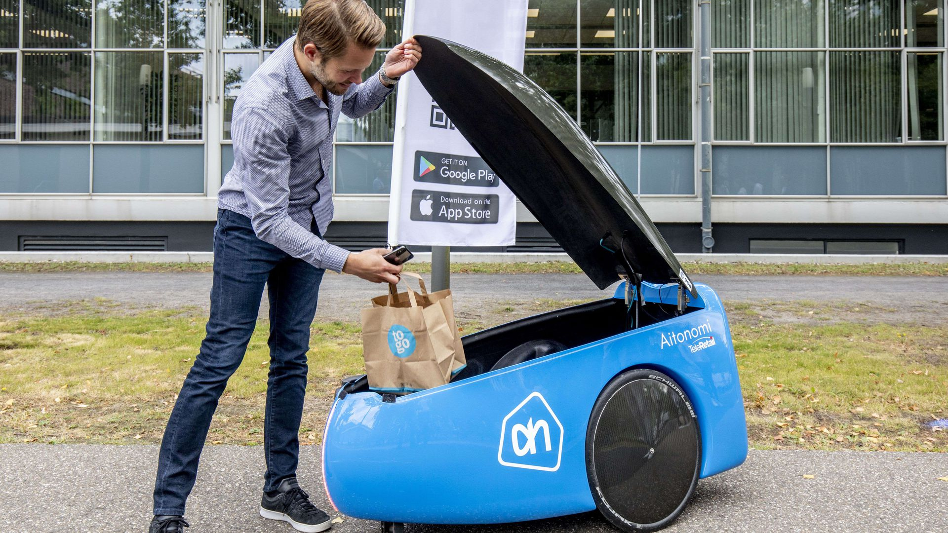 A man using a delivery robot.