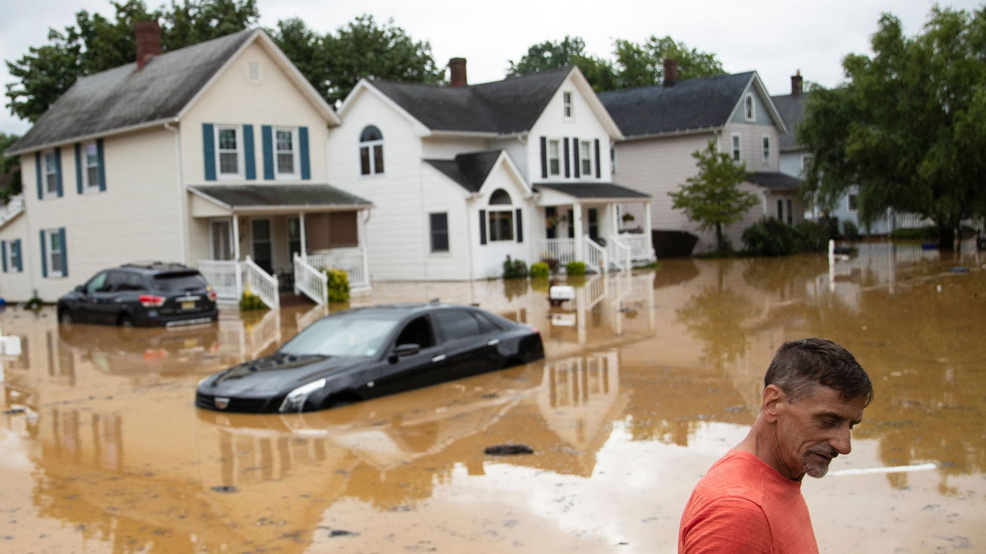 Bruce, an evacuated resident, wades through high water following a flash flood, as Tropical Storm Henri makes landfall, in Helmetta, New Jersey, on August 22