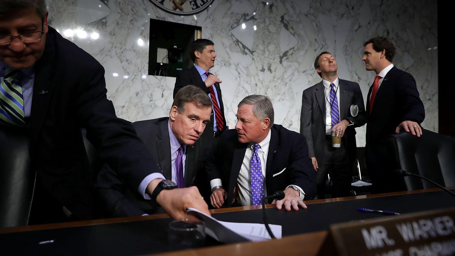 Senate Intelligence Committee Chairman Richard Burr (R-NC) talks with ranking member Sen. Mark Warner (D-VA). Photo: Chip Somodevilla/Getty Images