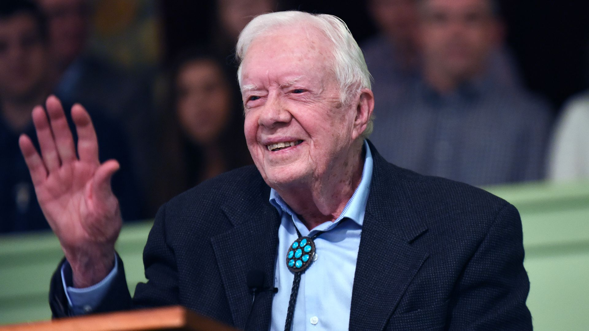 Jimmy Carter at his church waving to people.