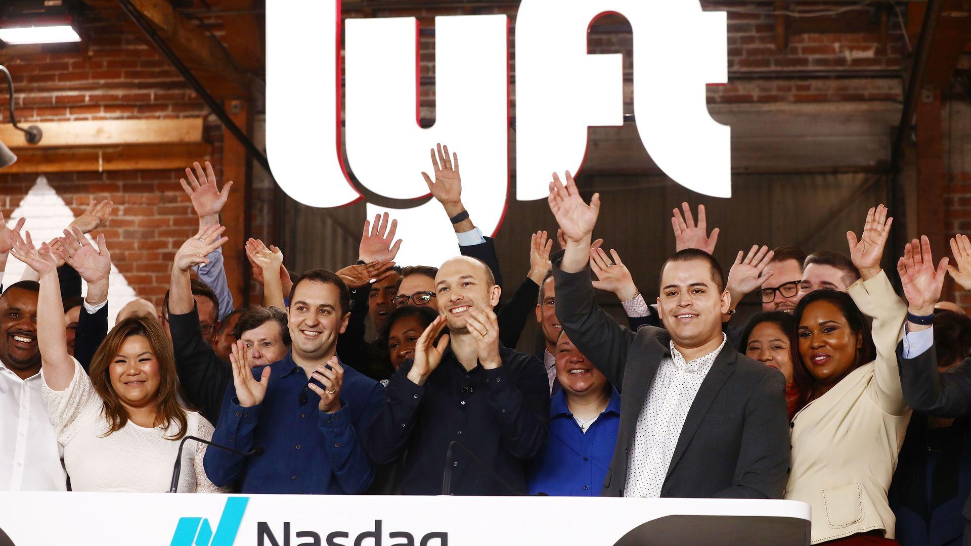 Lyft employees ring nasdaq bell