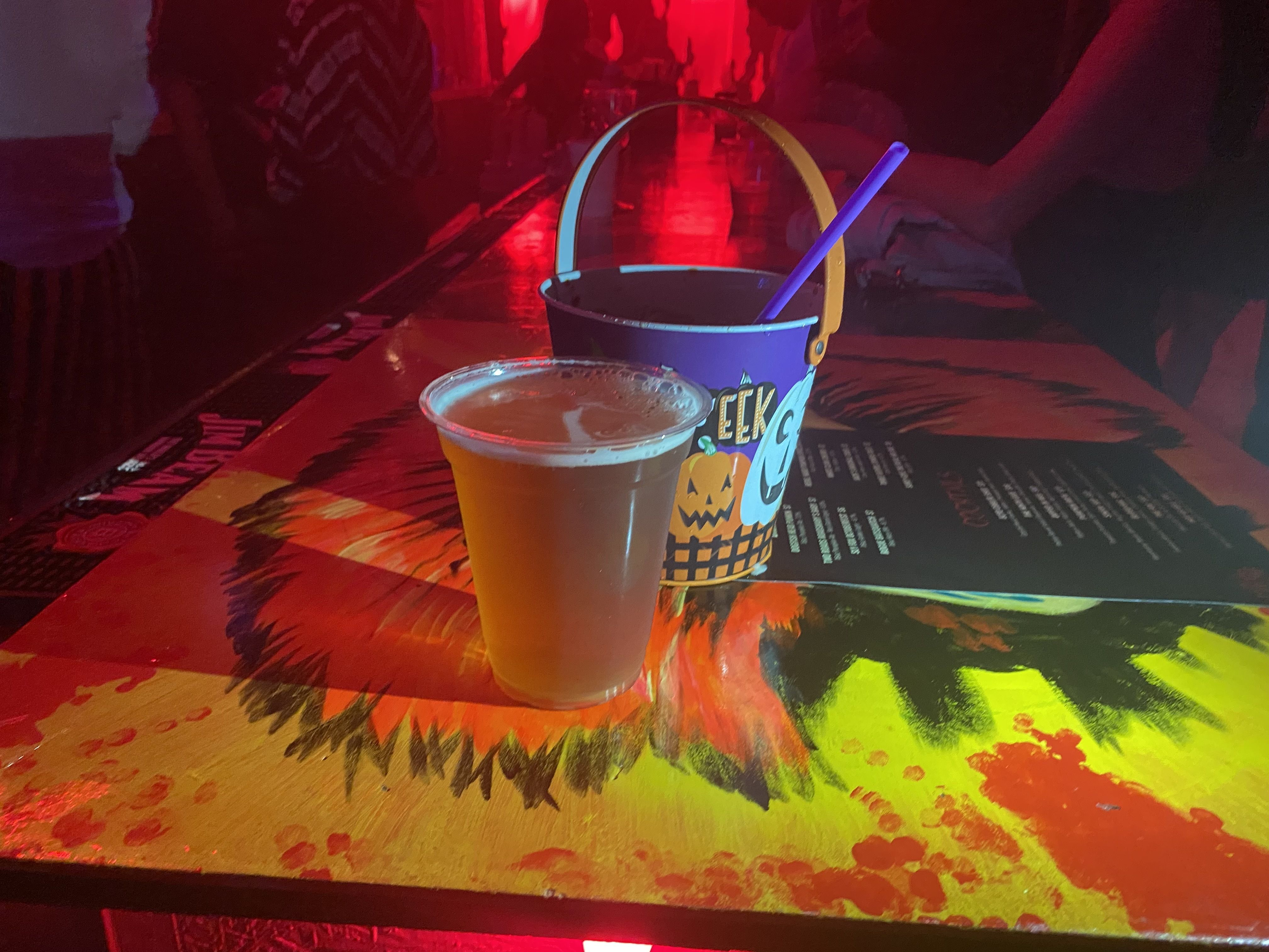 A draft beer and a Pumpkin Brew at Nightmare Before Tinsel. Photo: Taylor Allen/Axios