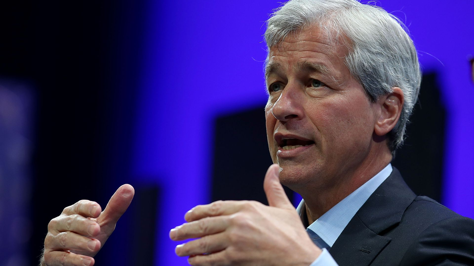 J.P. Morgan CEO Jamie Dimon gesturing in front of a crowd.