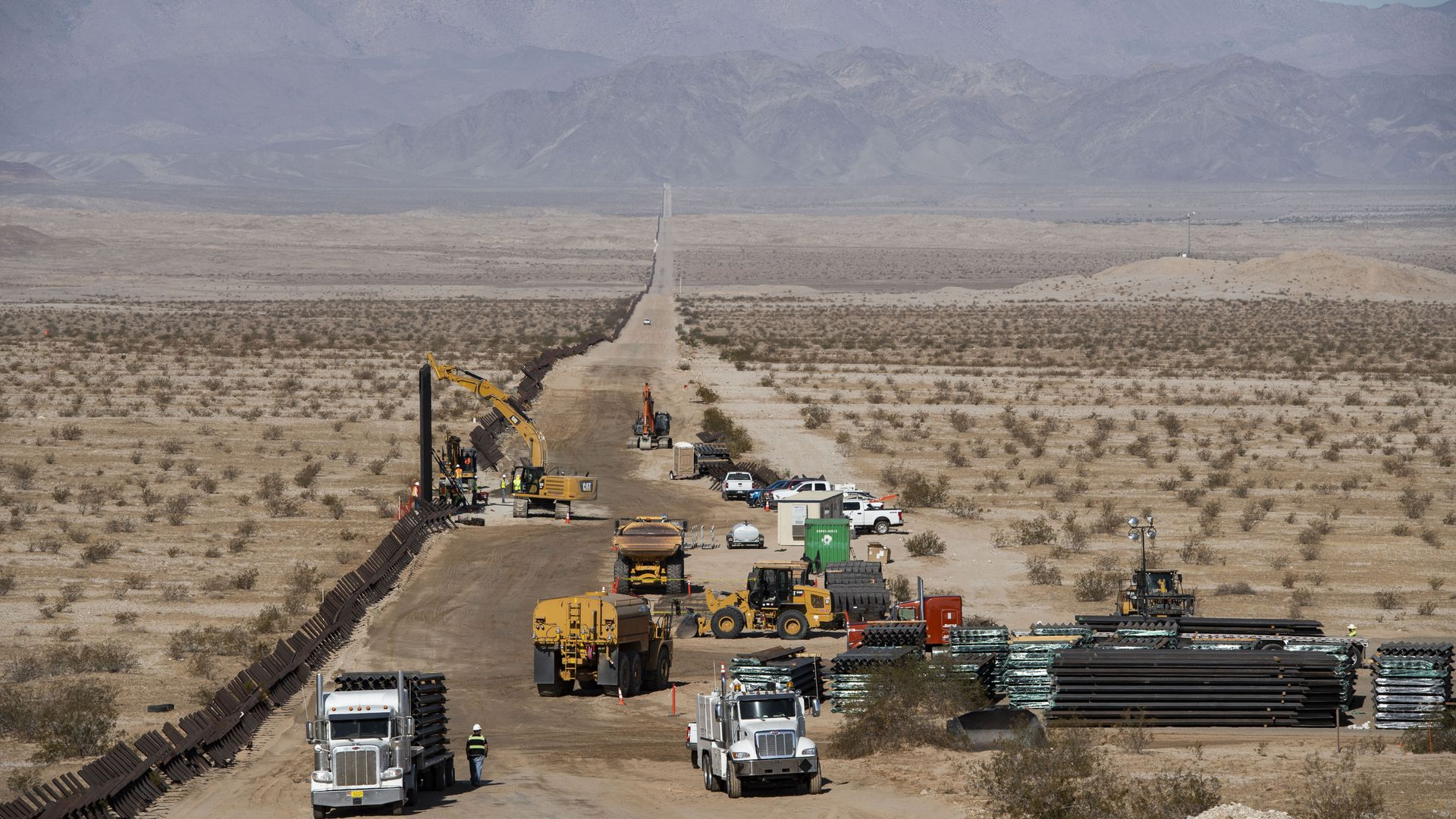 Construction begins along the U.S. border with Mexico where the new border wall will replace old fencing on August 23