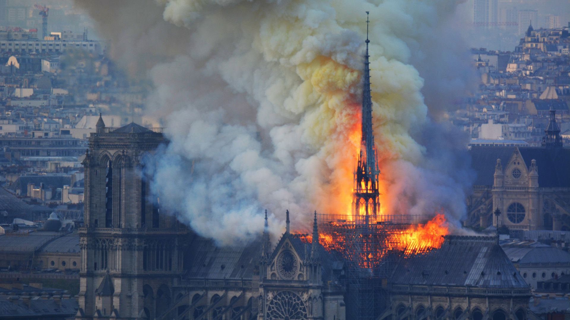Smoke and flames rise during a fire at the landmark Notre-Dame Cathedral in central Paris on Monday.