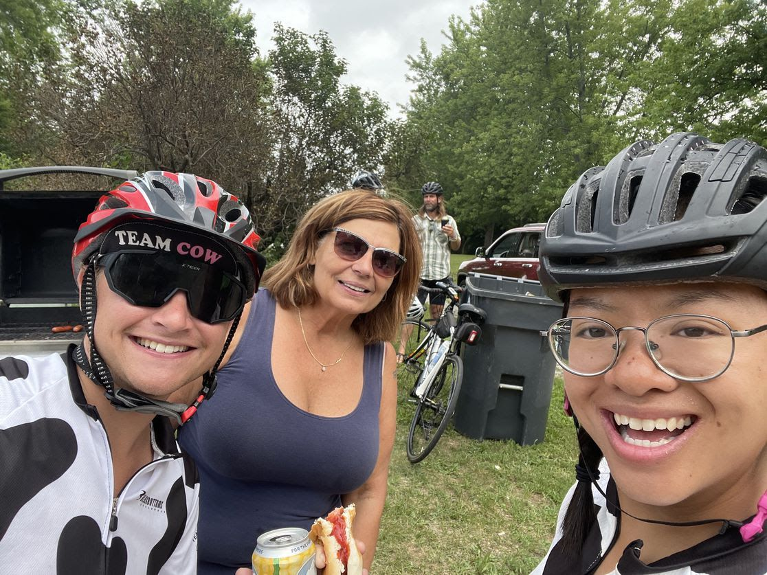 Axios' Linh Ta poses in a biking helmet with two women.