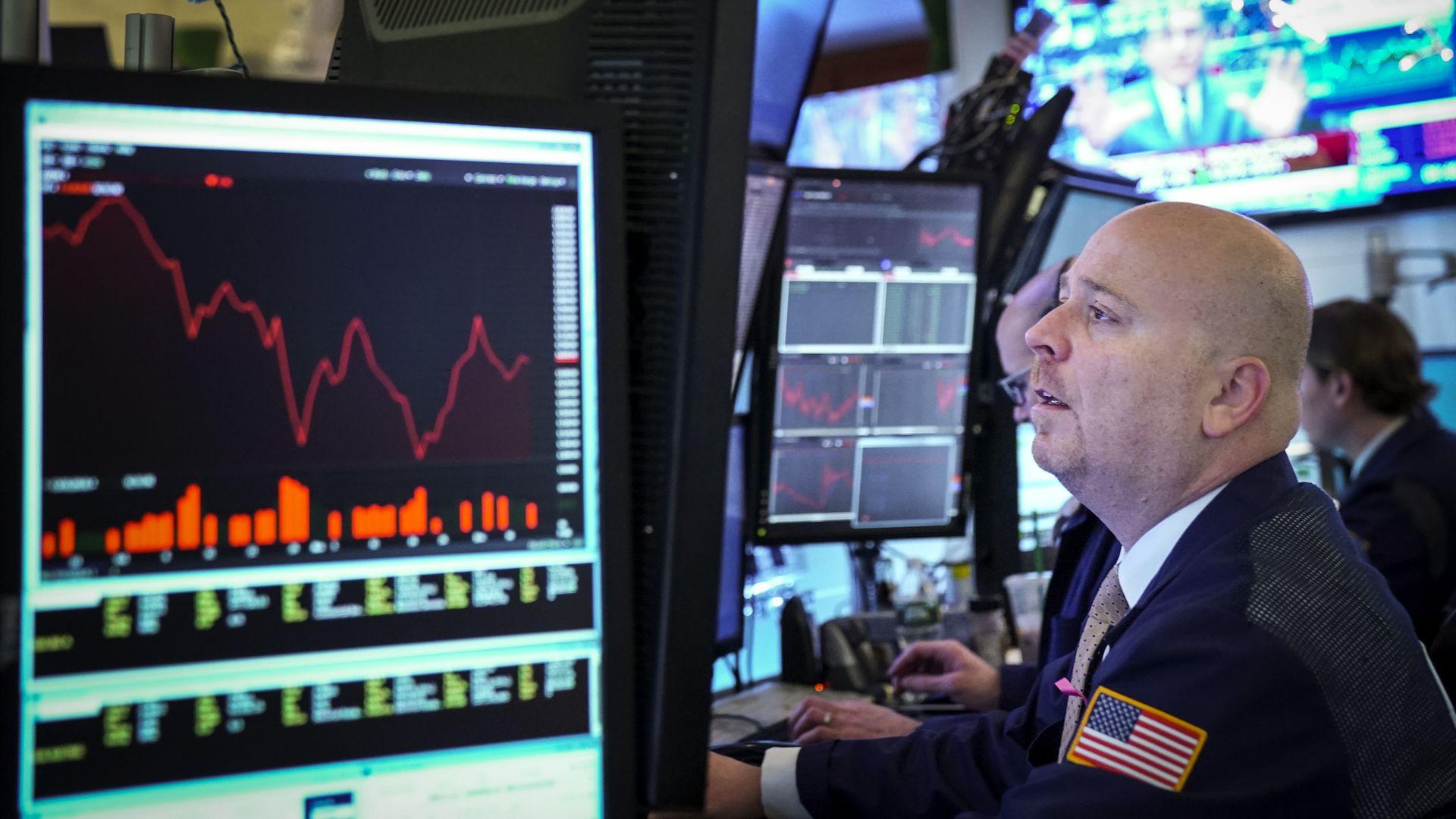 Stock trader looking at screen