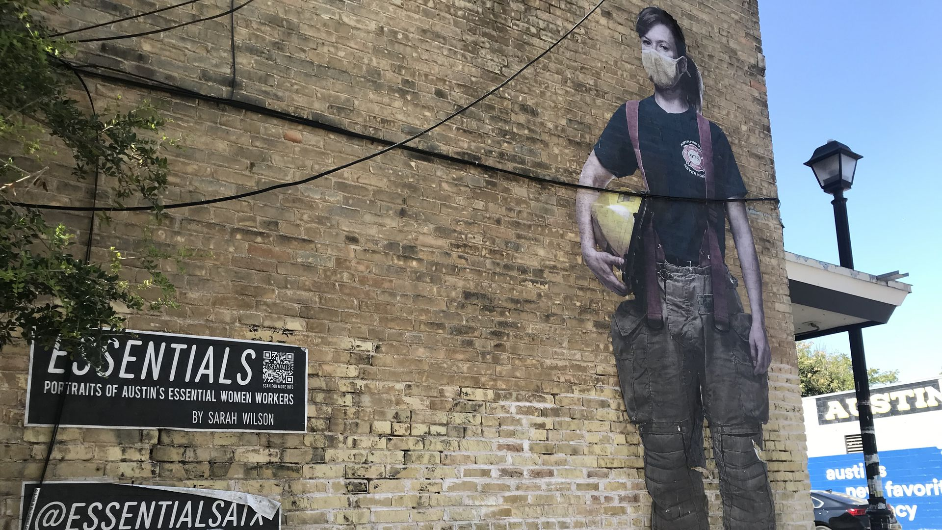 An East Austin mural by Sarah Wilson of an essential woman worker.