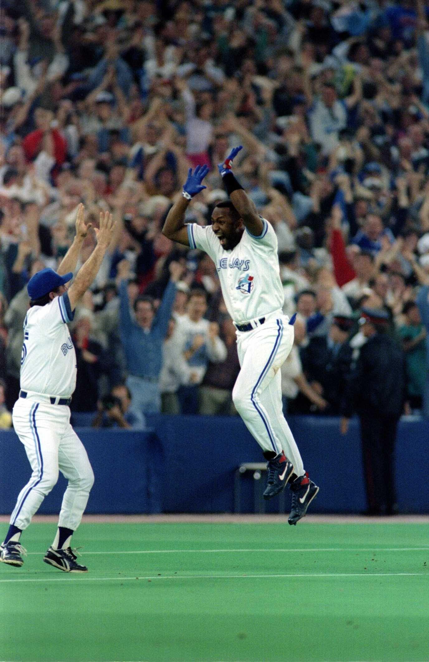 Joe Carter celebrates his 9th inning, three-run home run.