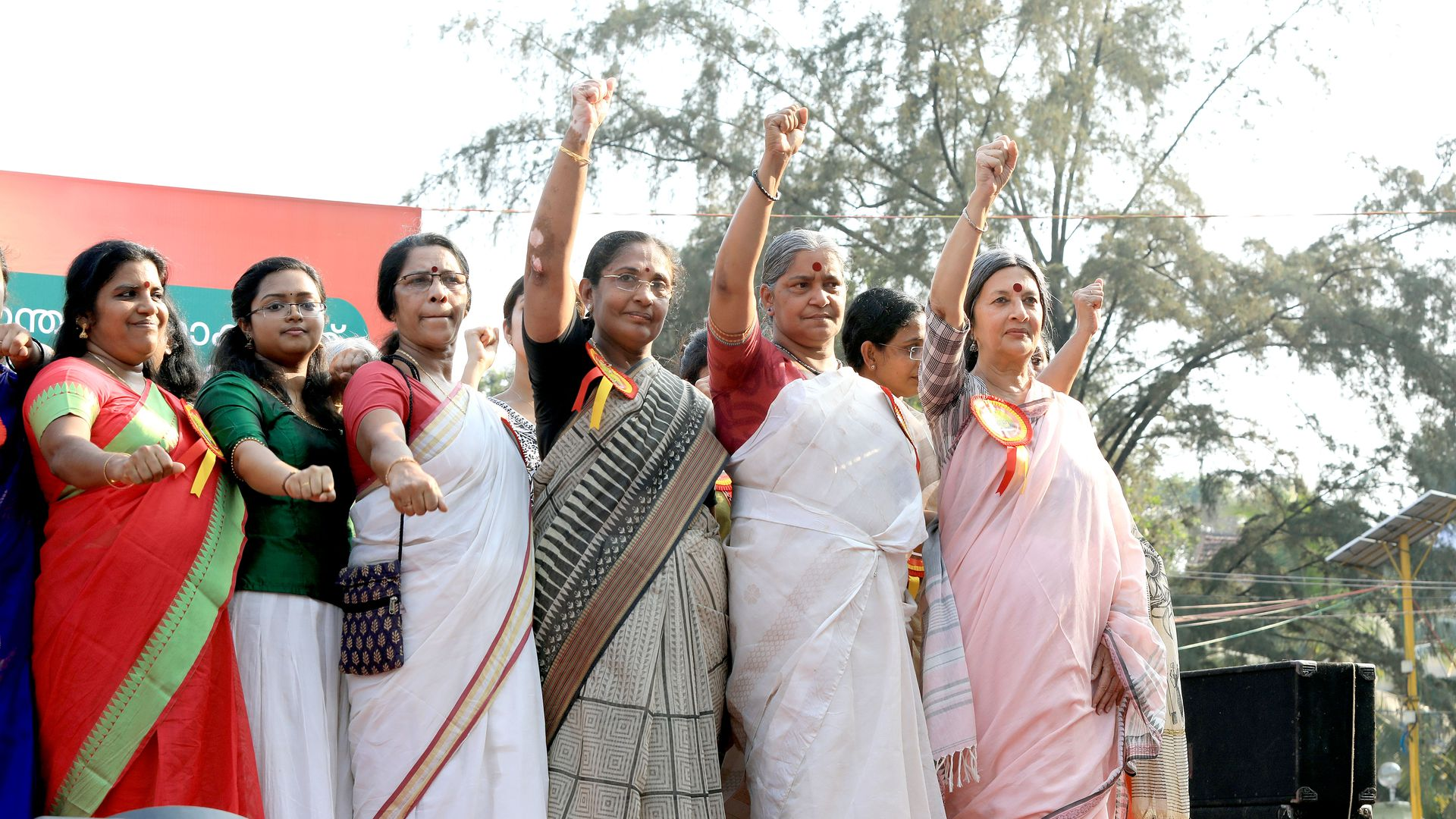 Women take oath as they gather to participate in the 620 km-long 'Women's Wall' against communalism and gender discrimination
