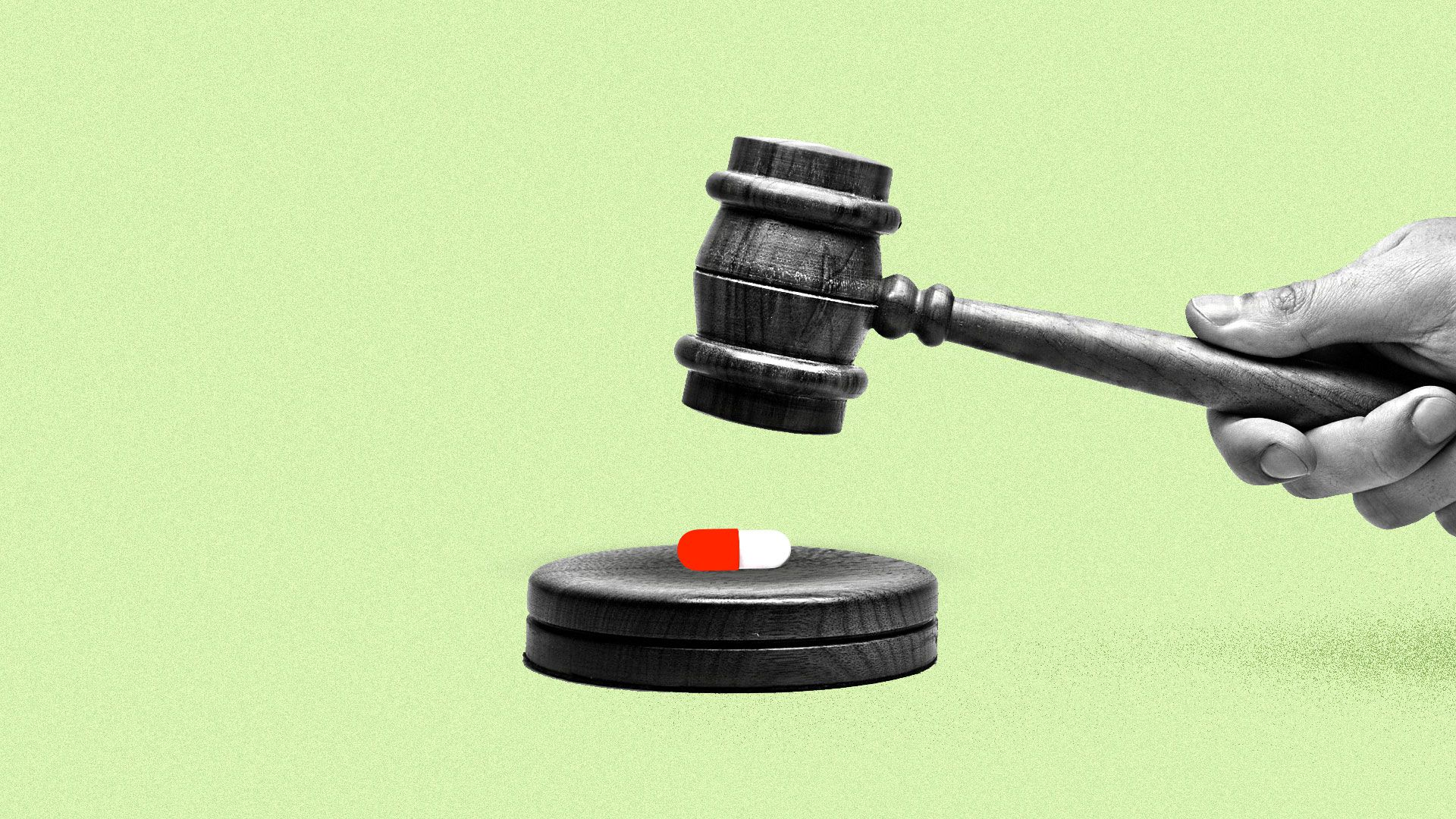 A judge's gavel about to crush a red and white pill