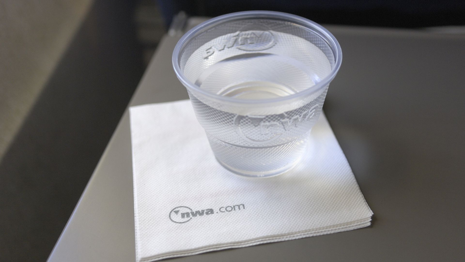 A cup of water on an airplane