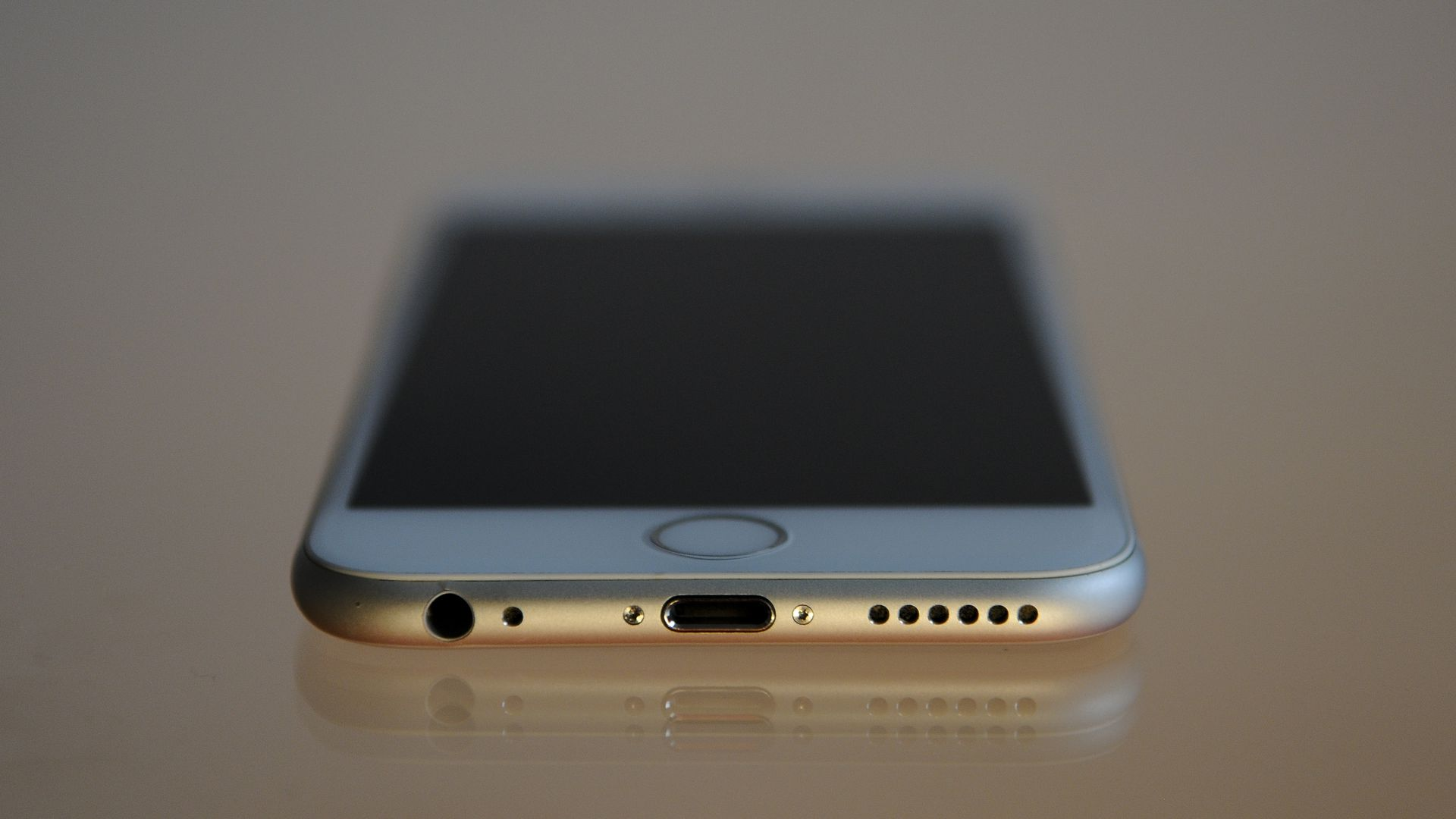An iPhone 6 viewed with the charging port in foreground
