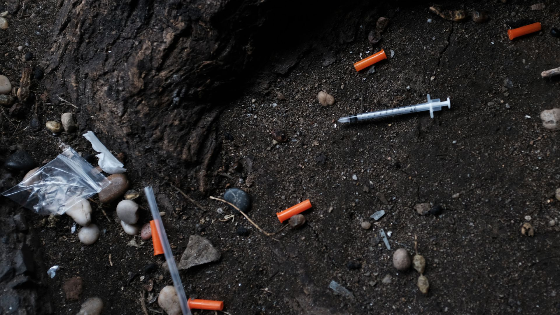 Hypodermic needles litter the ground in the South Bronx on March 13, 2019.