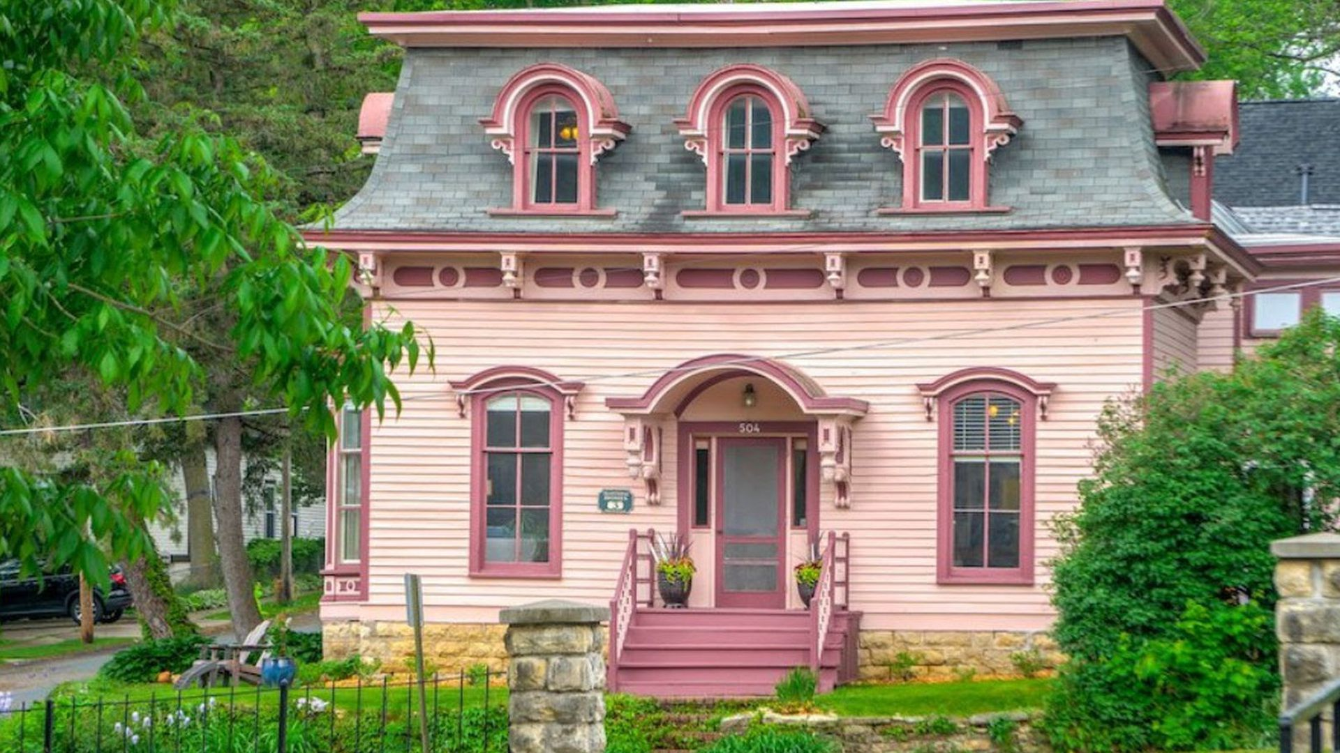 The exterior of the pink historic Ivory McKusick House in Stillwater, Minnesota.