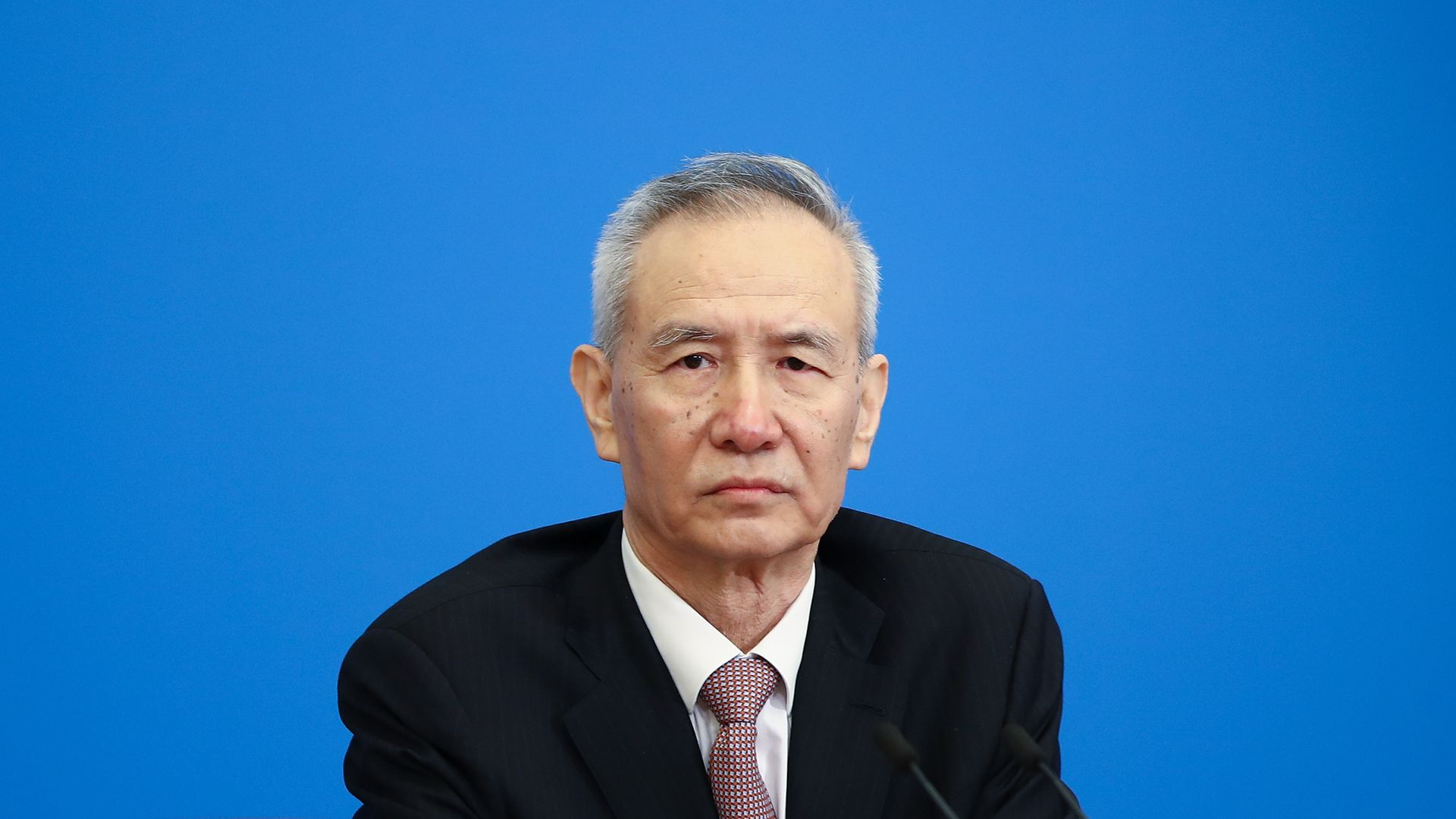 Chinese Vice Premier Liu He sitting at a March 20 news conference in Beijing.