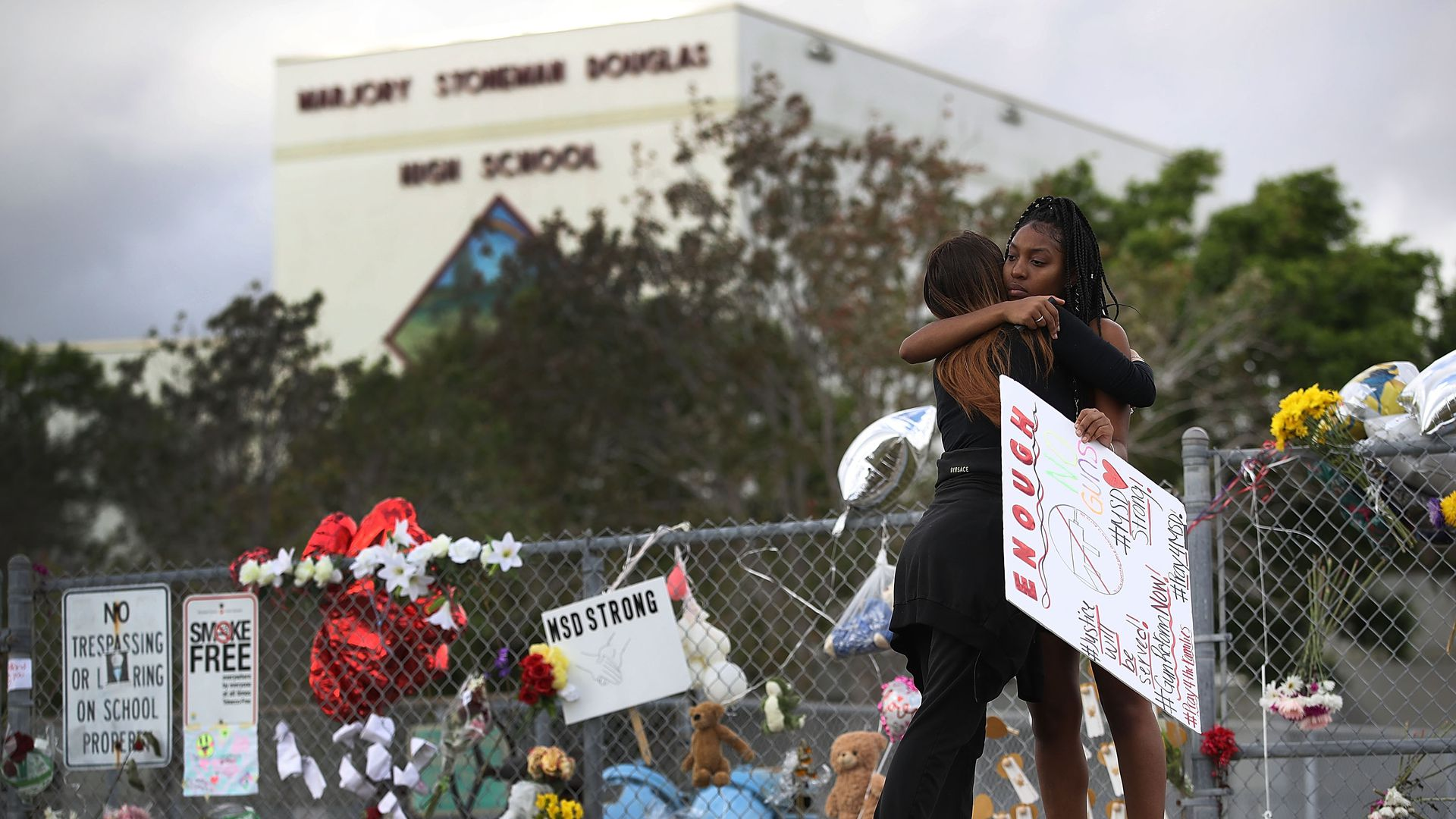 Students comforting each other after a shooting at Marjory Stoneman Douglas High School in Parkland, Florida