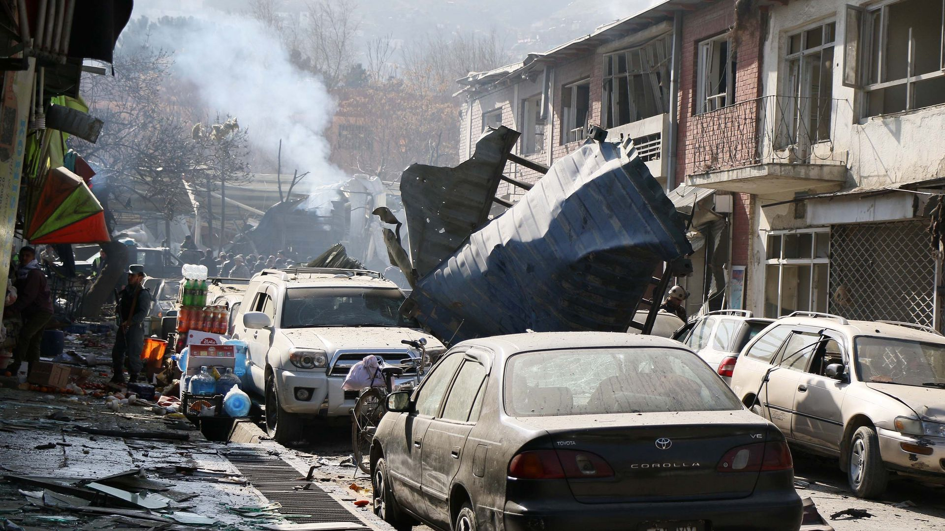 aftermath of a suicide car bombing on a Kabul street