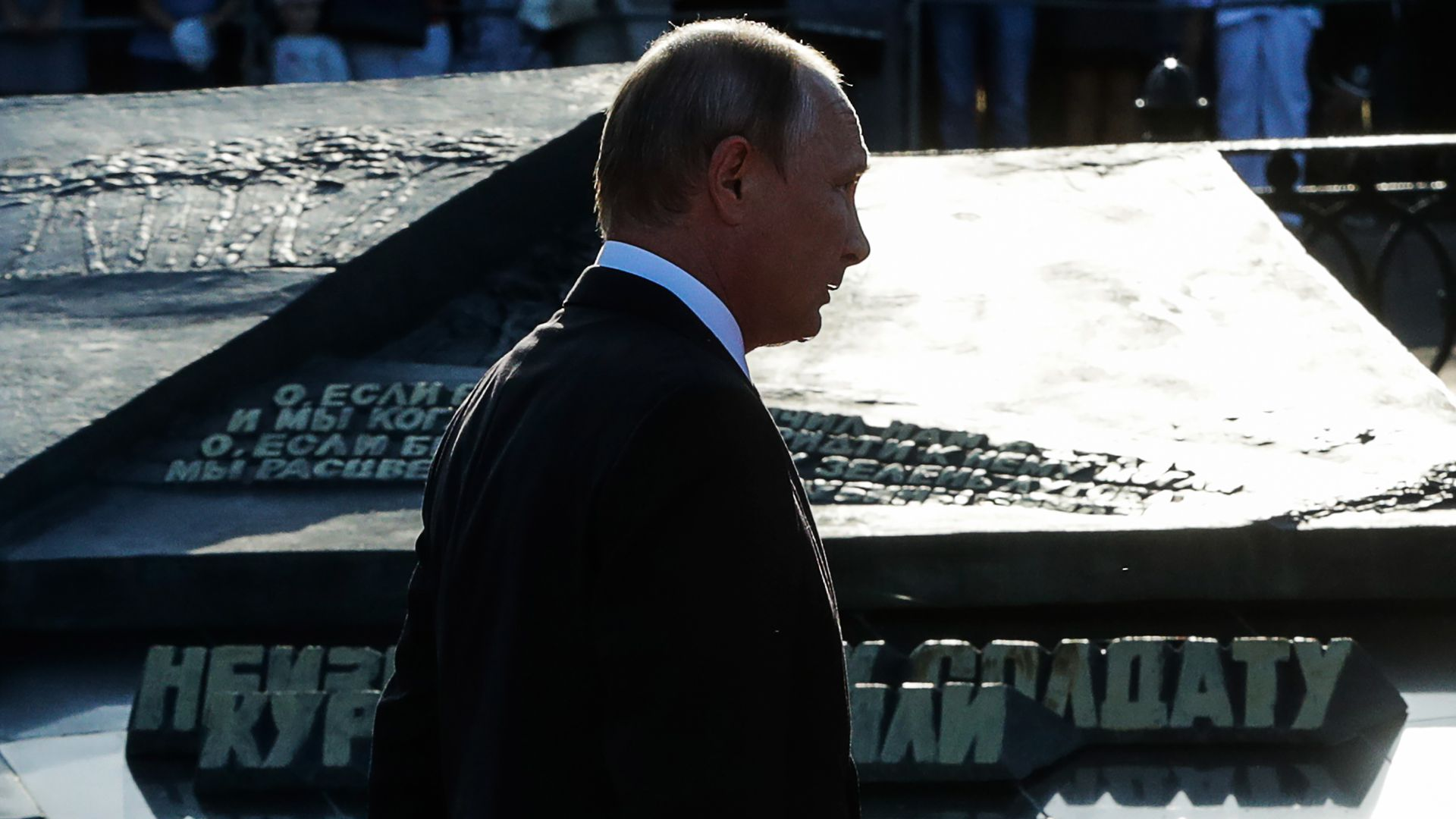 Vladimir Putin's profile as he's walking in a shadow