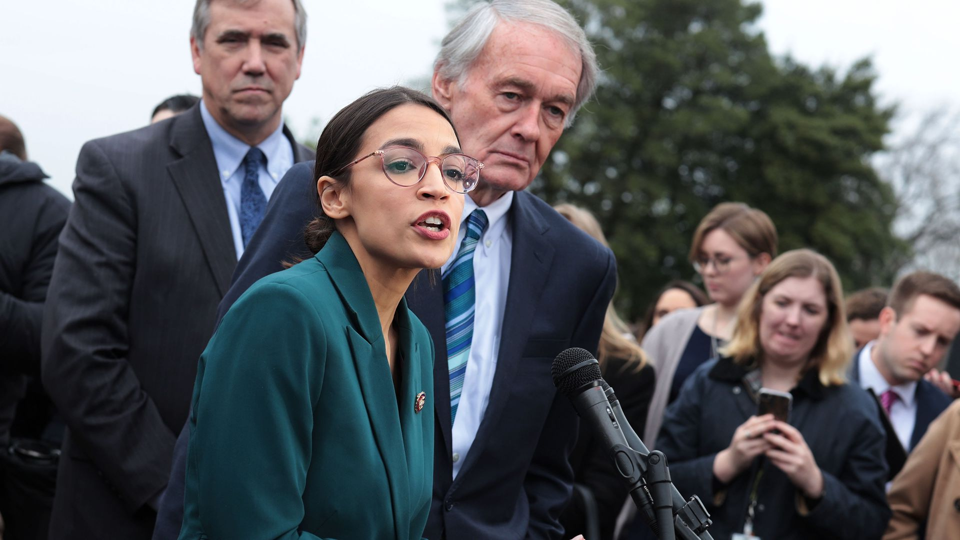 U.S. Rep. Alexandria Ocasio-Cortez (D-NY) speaks as Sen. Ed Markey (D-MA) (R) listens during a news conference
