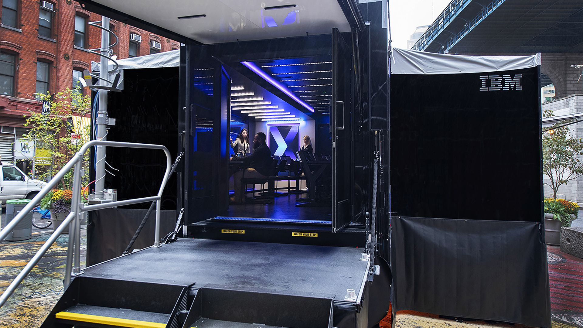 A picture of a door opening into IBM's mobile cybersecurity unit on a truck.