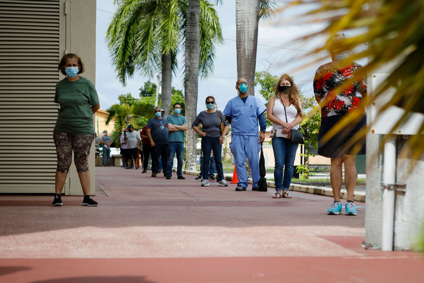 In photos: Florida breaks record for in-person early voting thumbnail