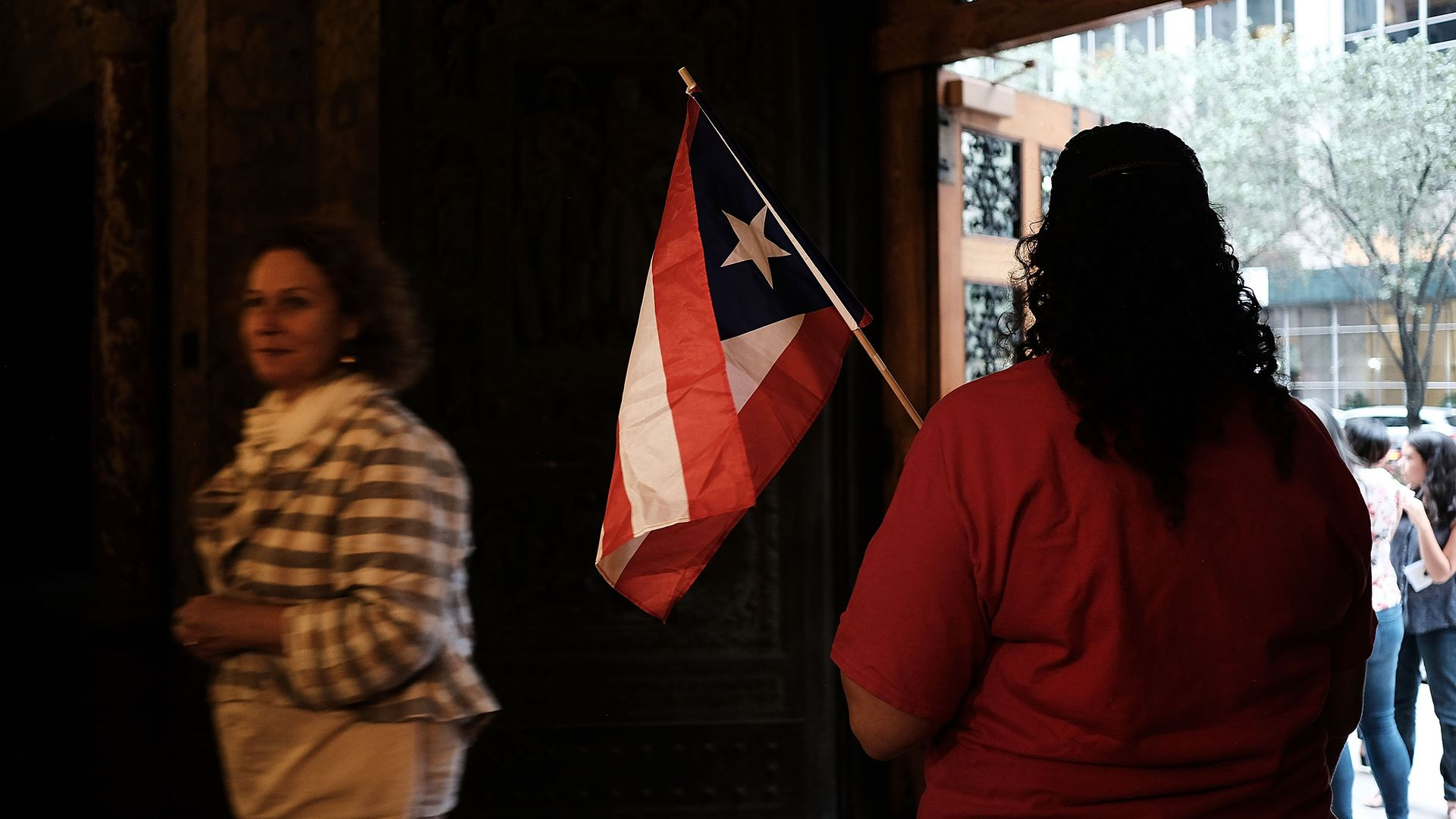 A person holds a Puerto Rican flag.