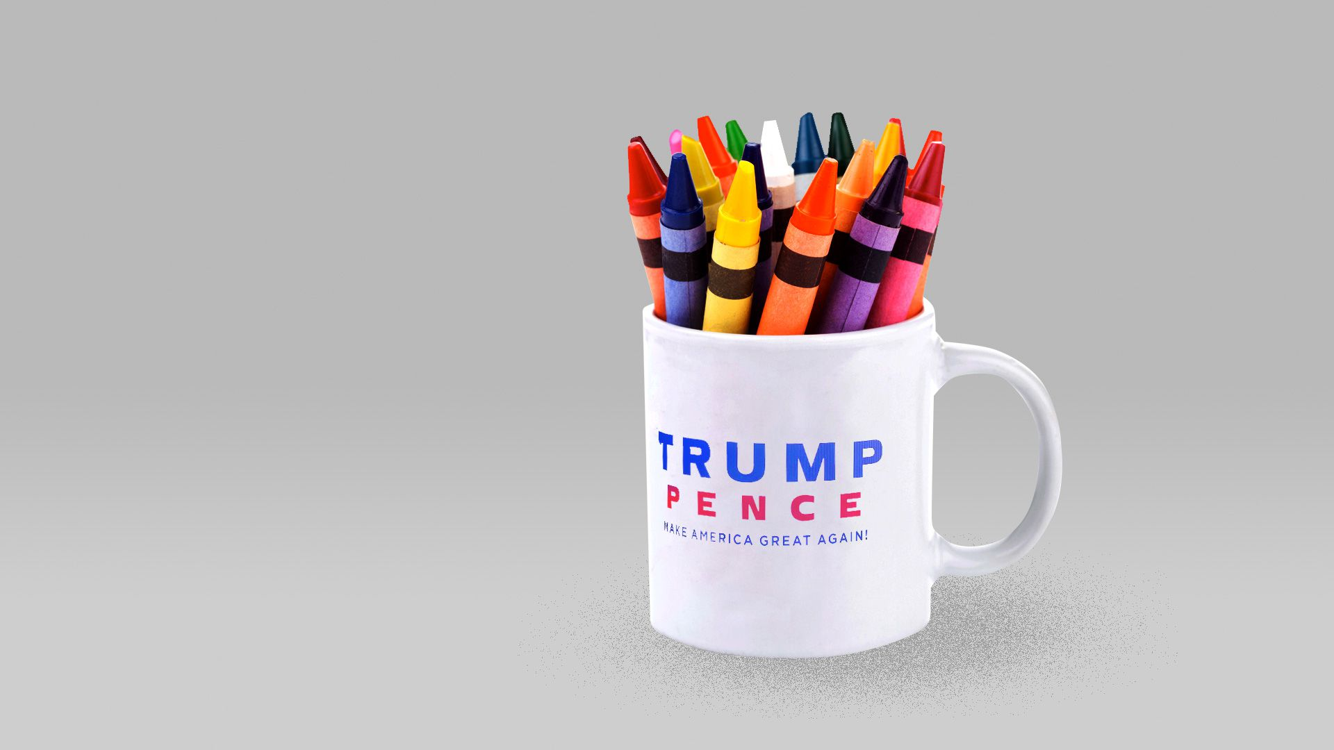 A coffee mug with the Trump/Pence logo holding crayons