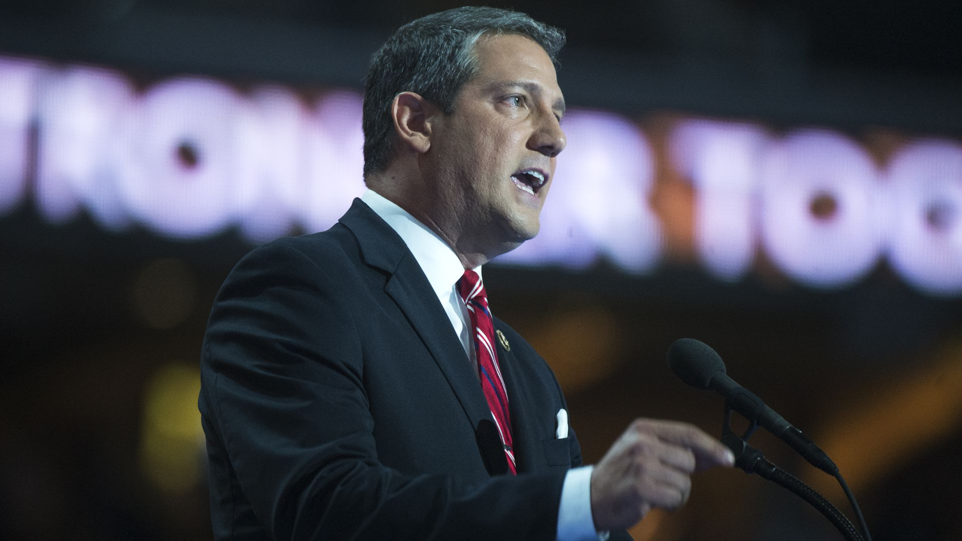 In this image, Tim Ryan speaks into a microphone on stage.