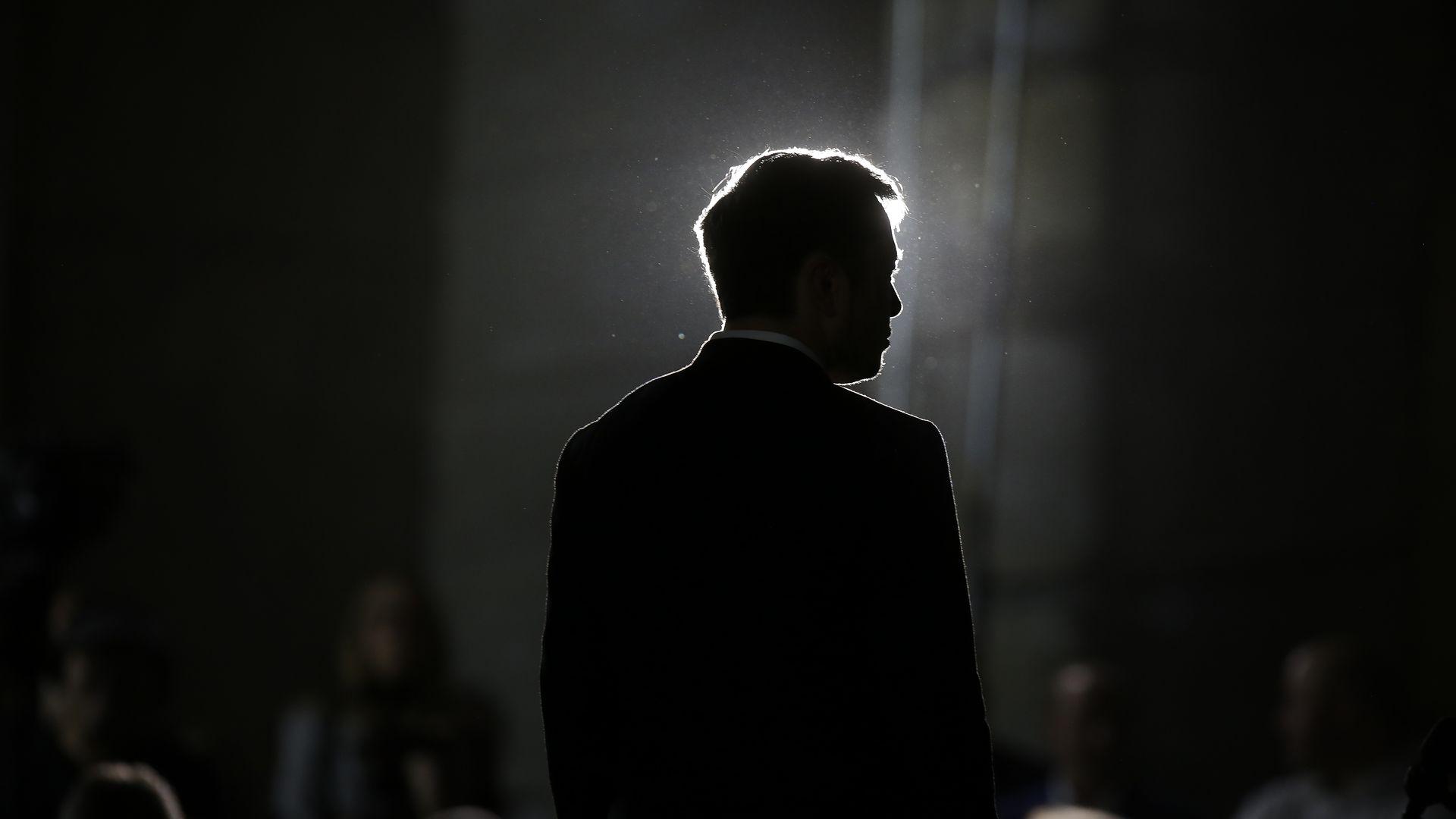 Silhouette of Tesla CEO Elon Musk.