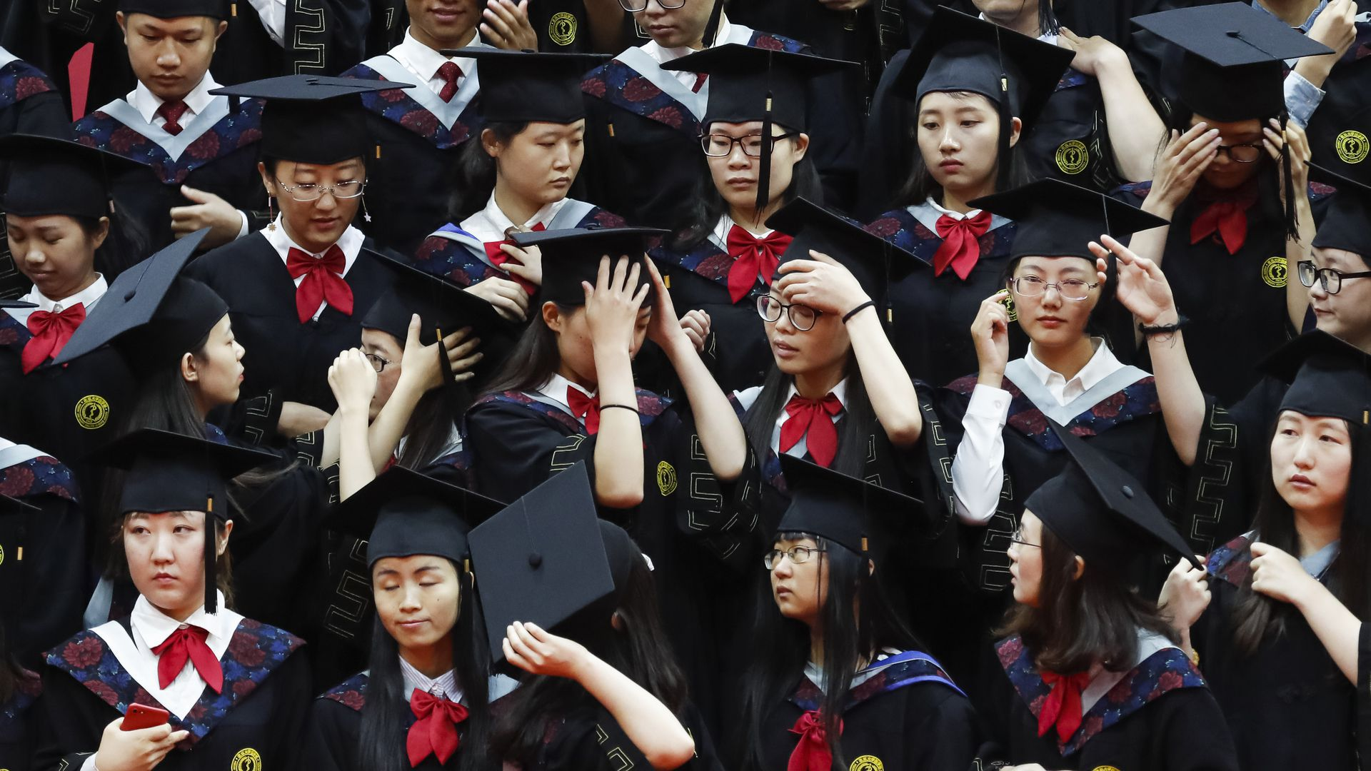 Students graduating university from Peking University.