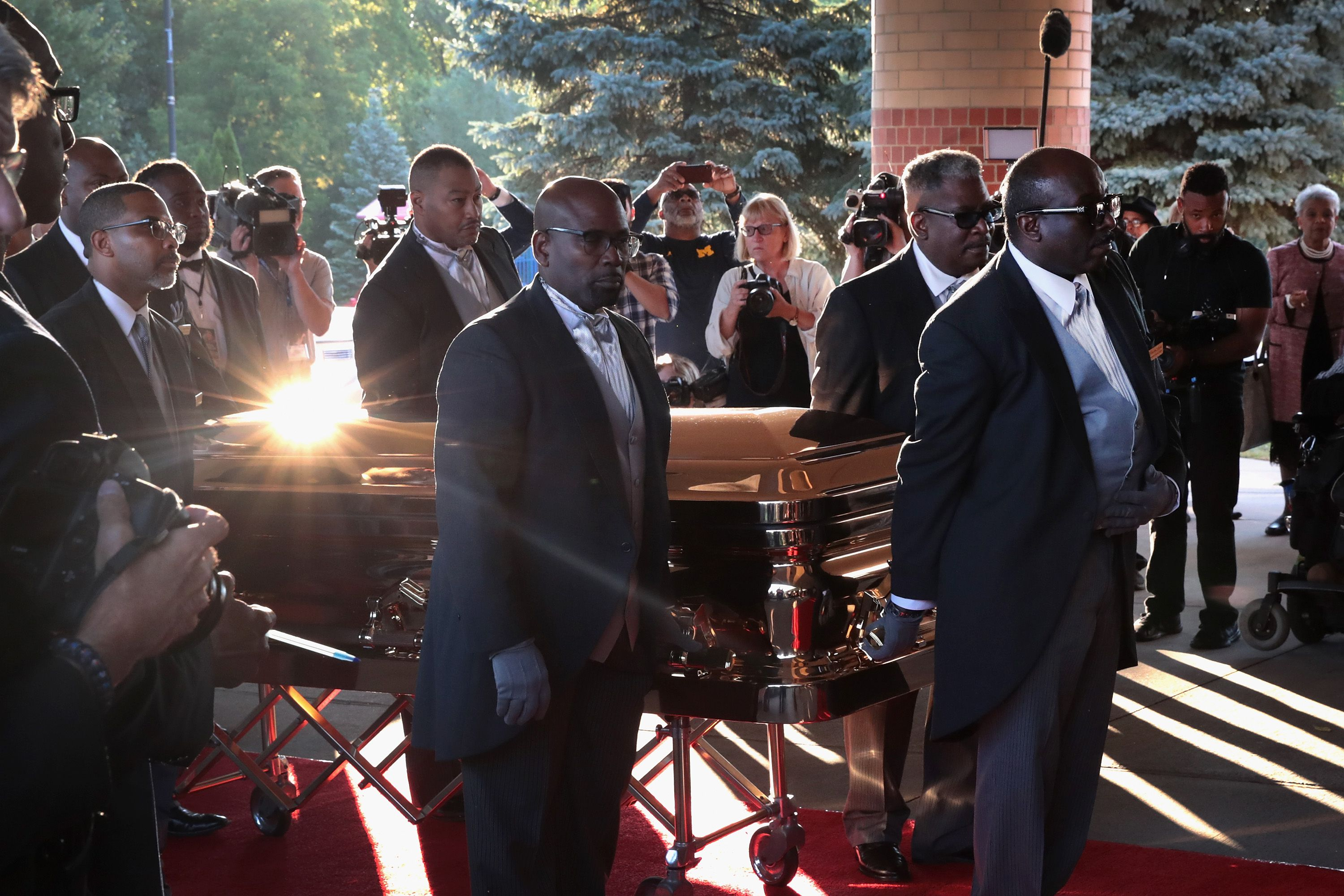 Men carry Aretha Franklin's casket.