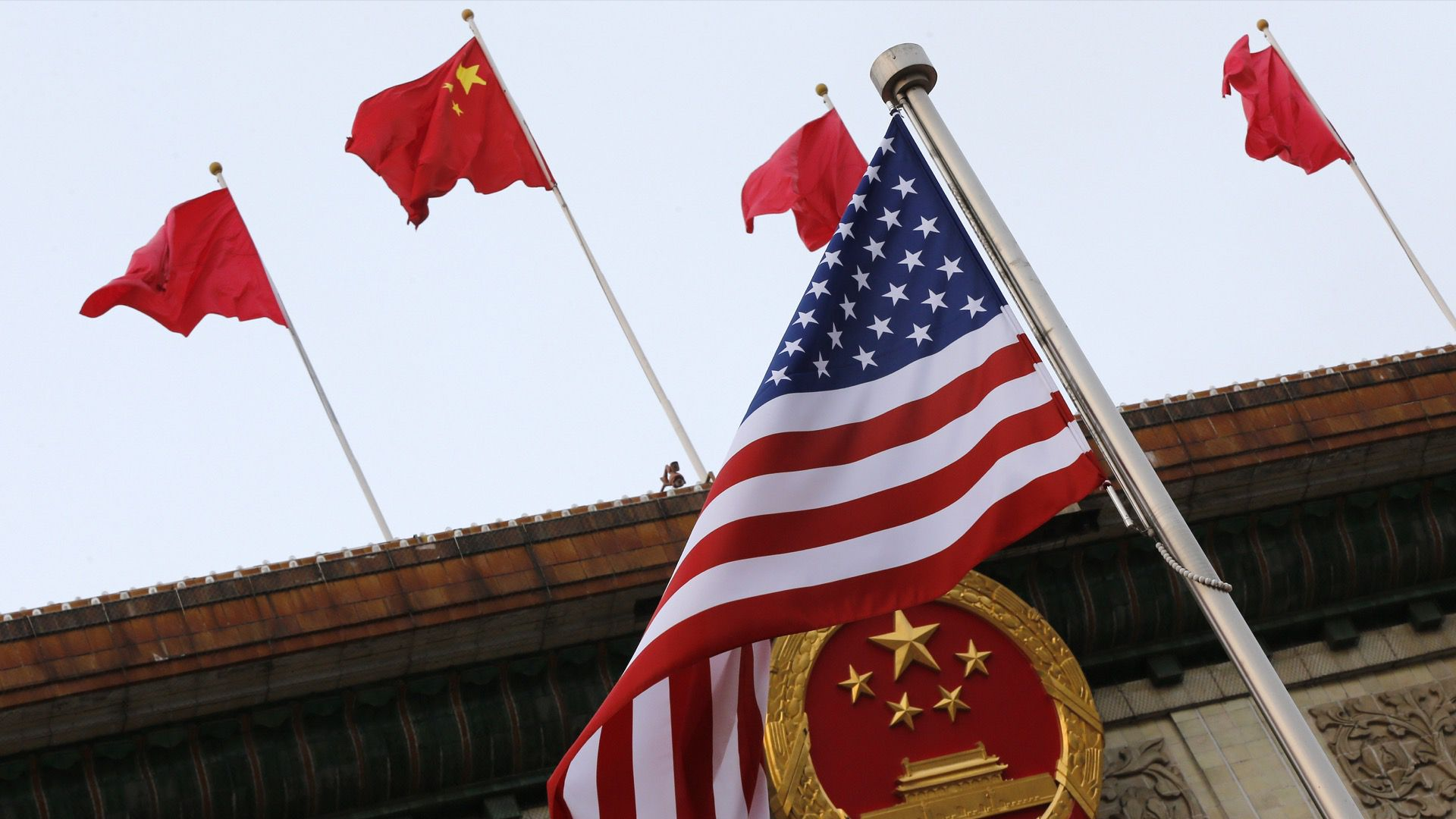 Chinese and American flags wave