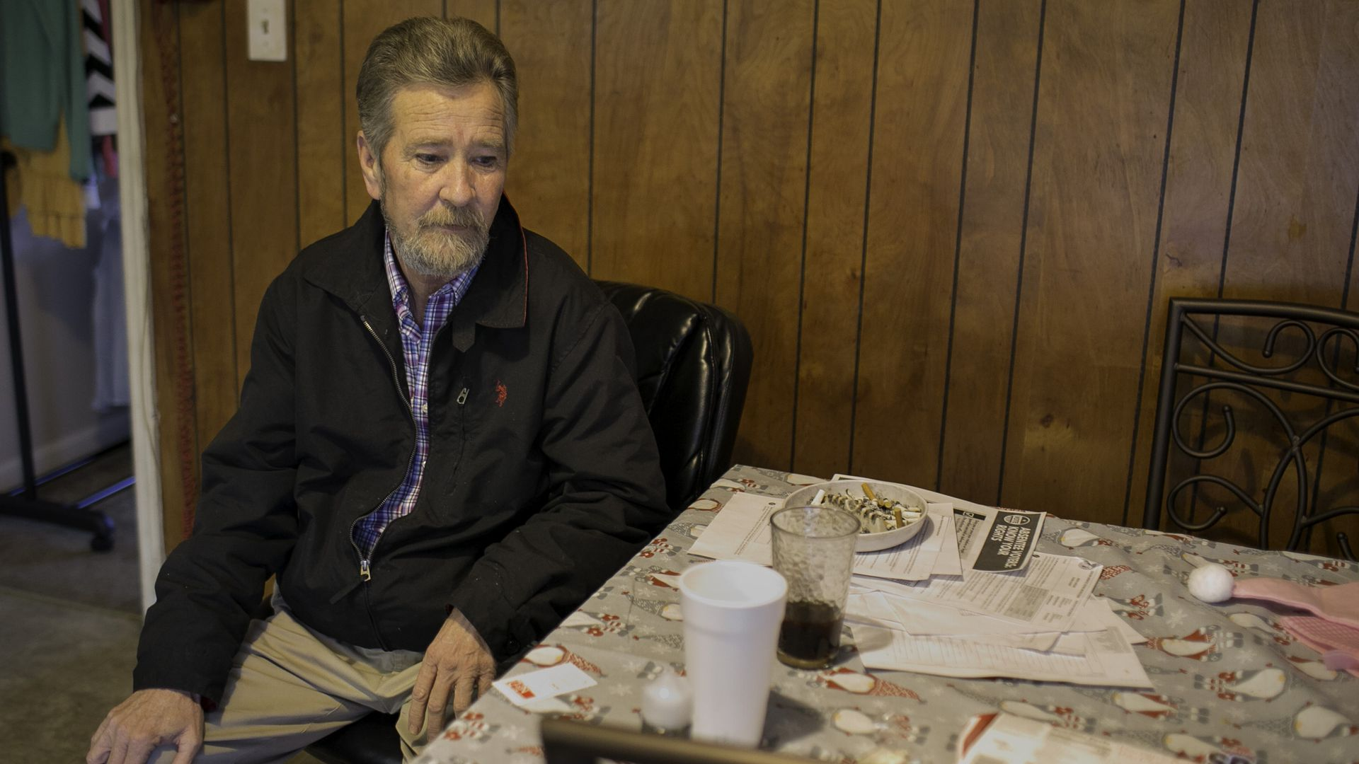 Leslie McCrae Dowless sits in his kitchen in Bladenboro, NC.