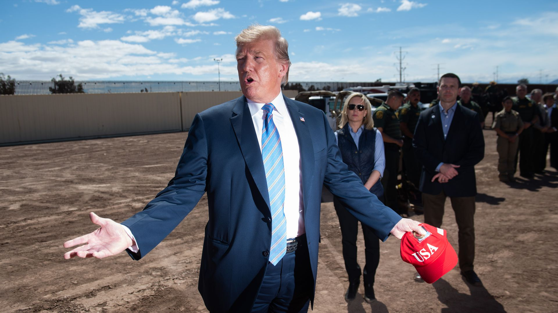 President Donald Trump tours the border wall between the United States and Mexico in Calexico, California, April 5.
