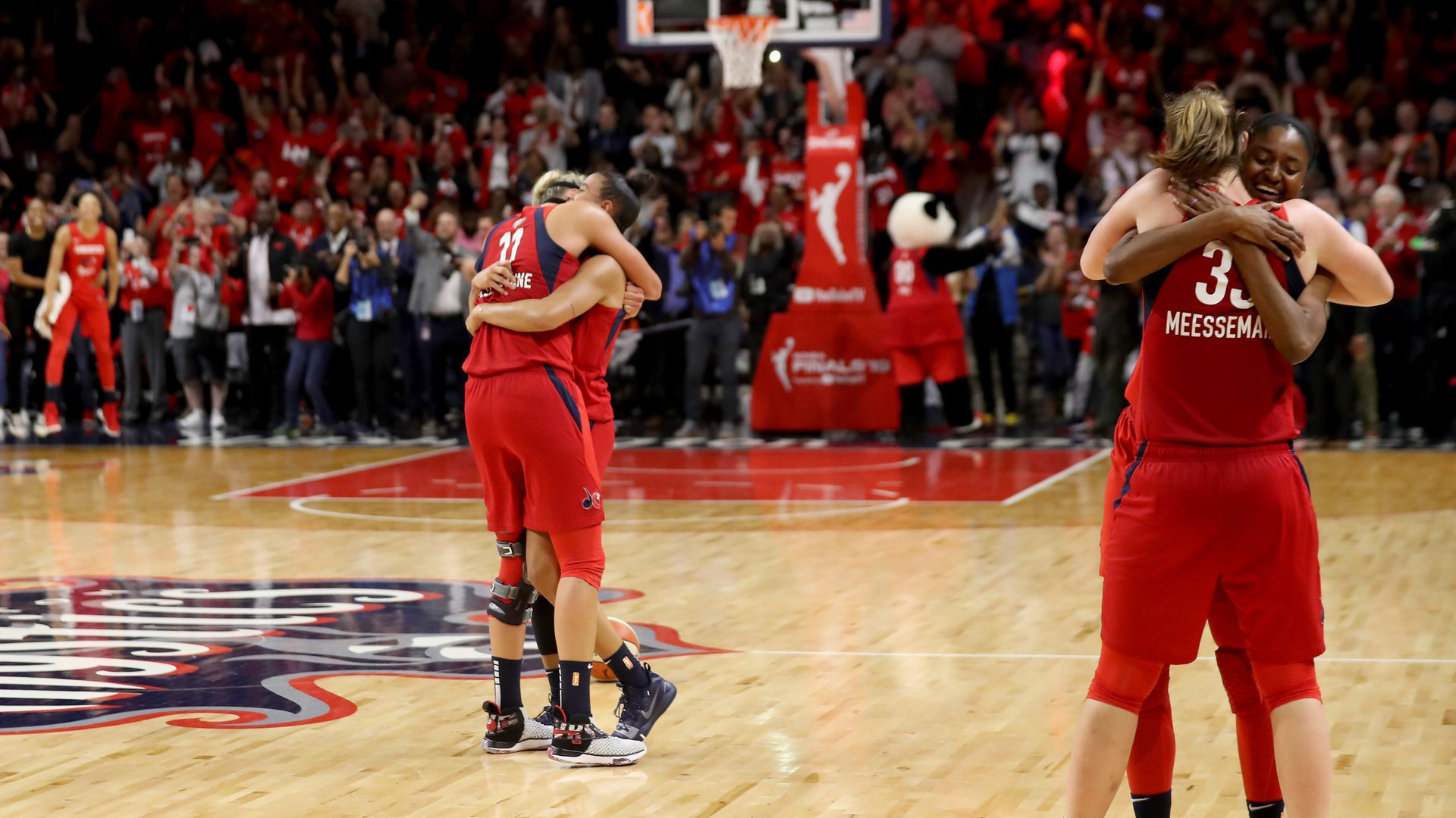 Mystics players hugging