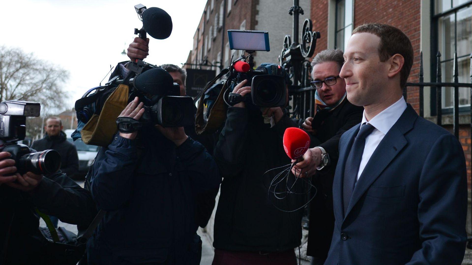 Facebook CEO Mark Zuckerberg in front of a bunch of TV cameras