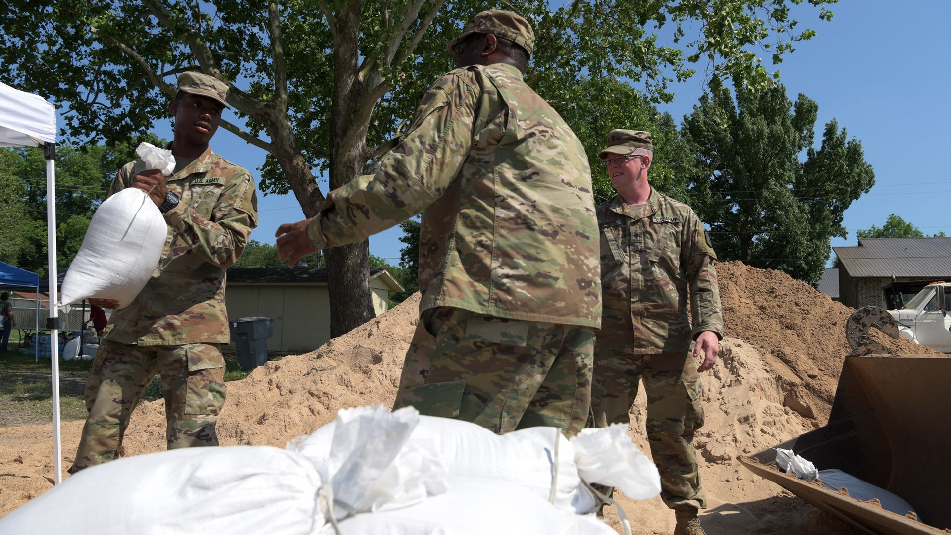 Arkansas National Guard Soldiers assist the U.S. Army Corps of Engineers and the city of Dardanelle, Arkansas, fill and load sandbags in preparation for flood waters near the city.