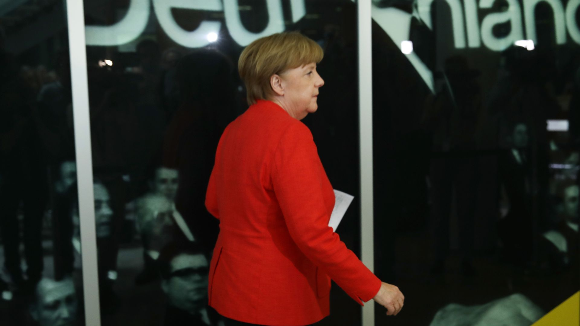 Angela Merkel in a red suit