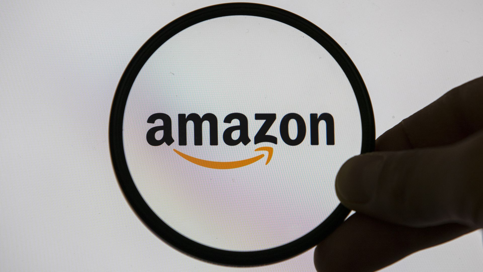 Amazon logo in a magnifying glass.