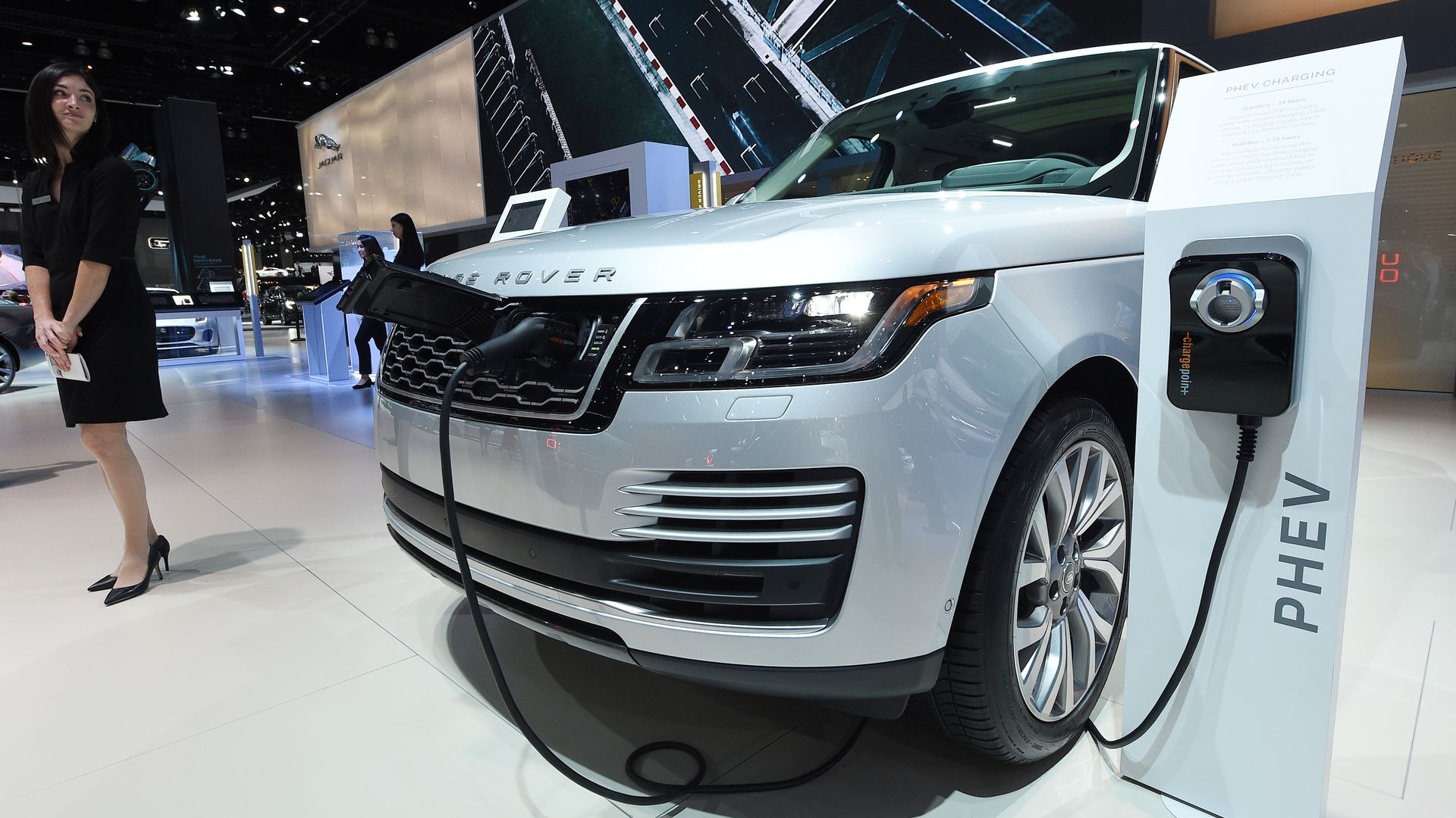 Hybrid Range Rover model and charging station at car show