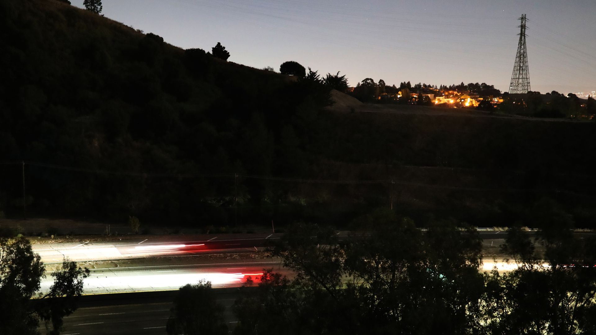 Streaks of lights from vehicles drive along highway 24 during the PG&E power outage in Oakland, Calif., on Thursday, Oct. 10