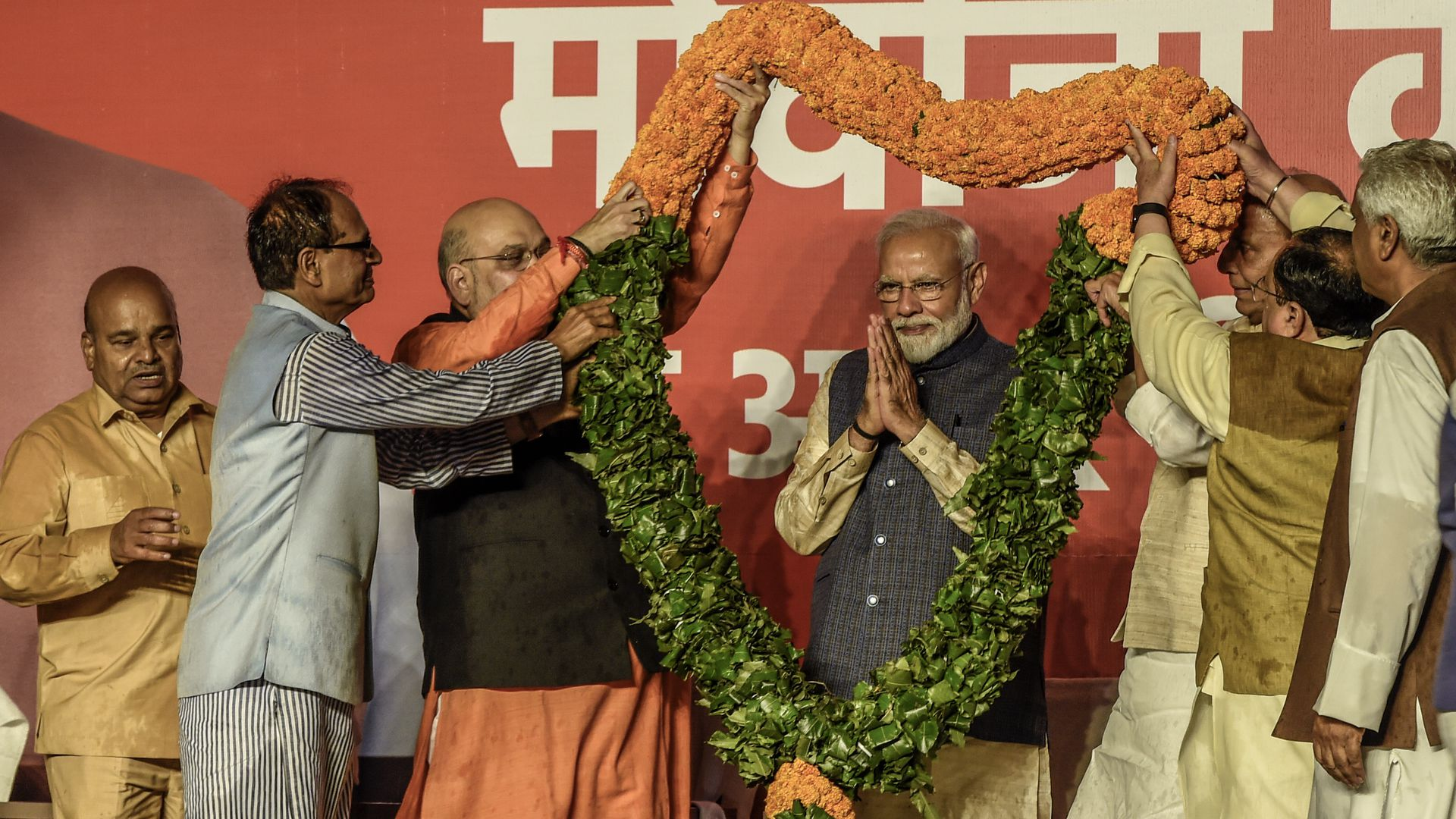Narendra Modi with a large floral garland
