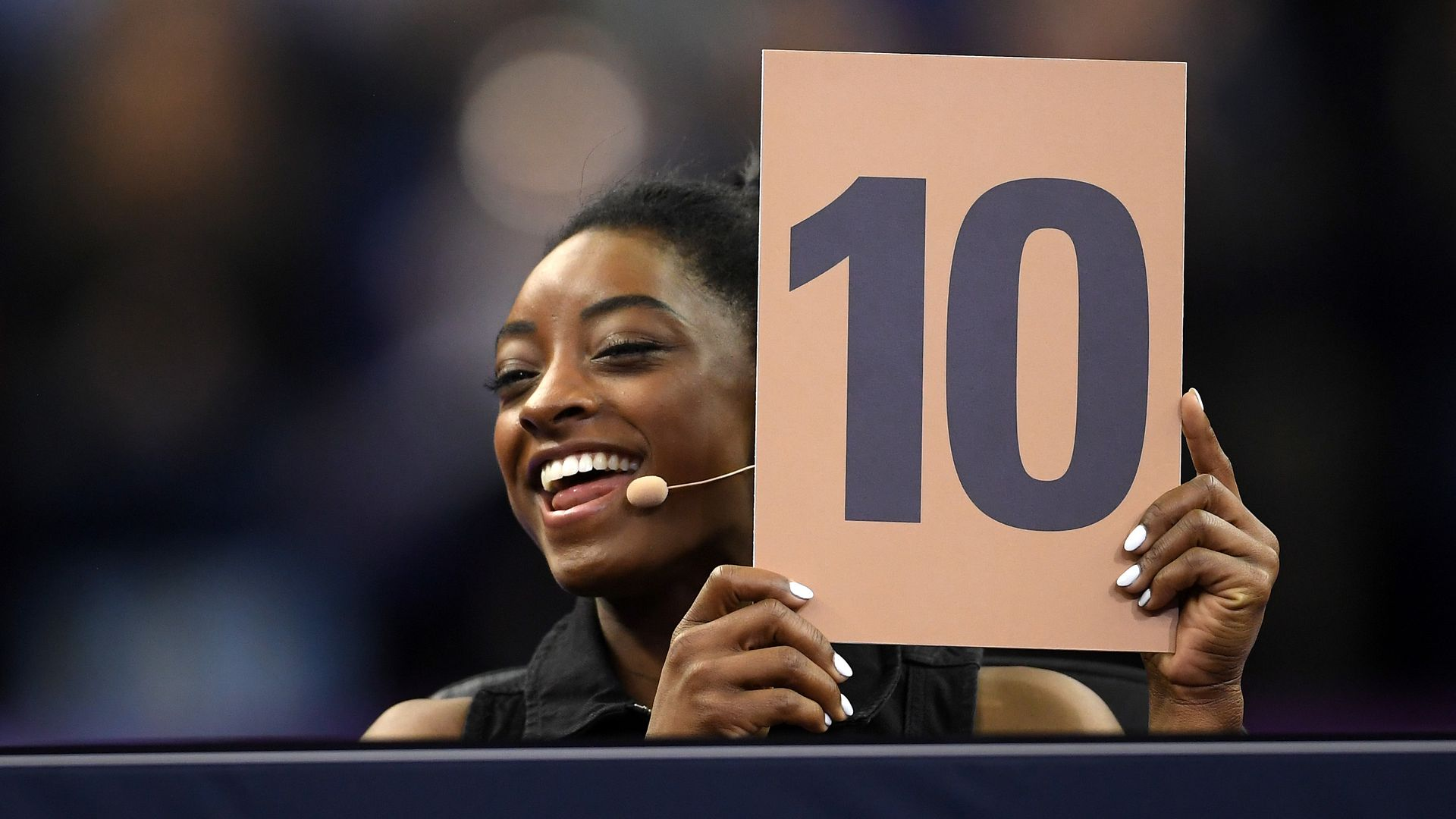 Judge, Simone Biles of the USA awards