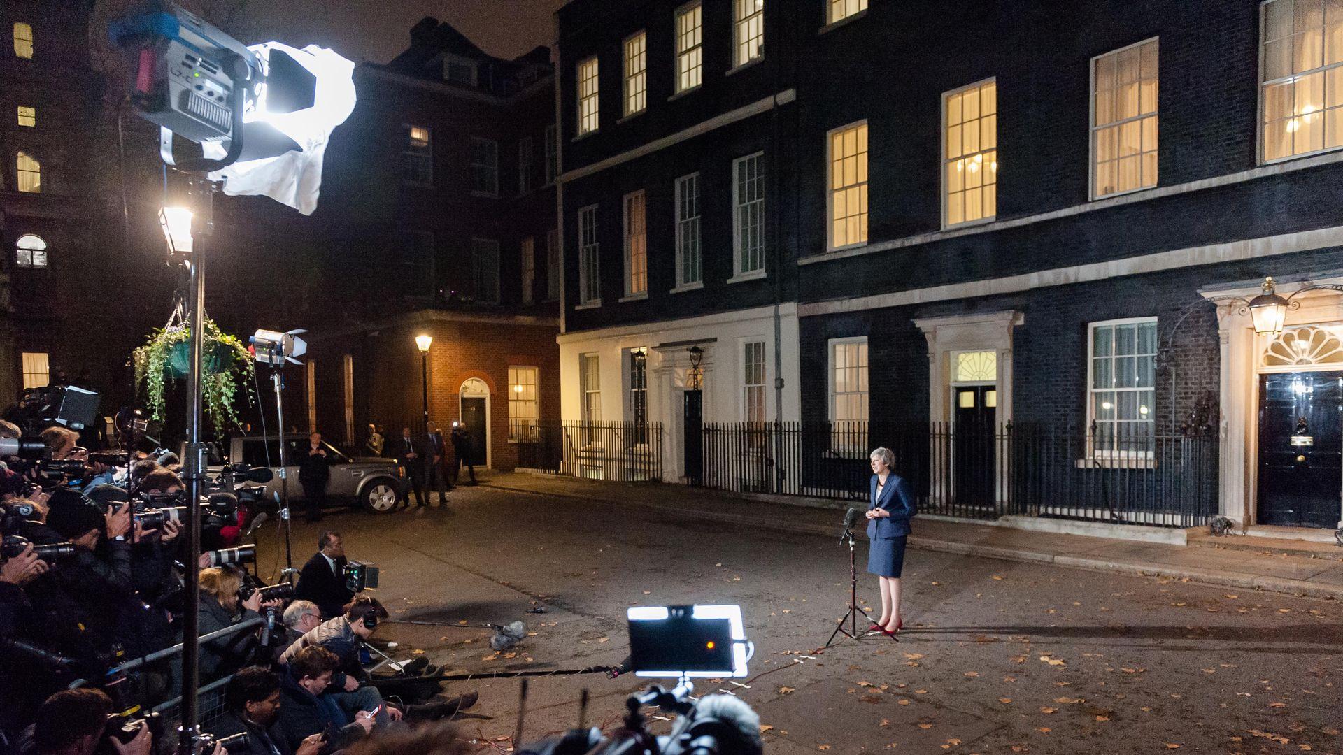 Theresa May at a press conference